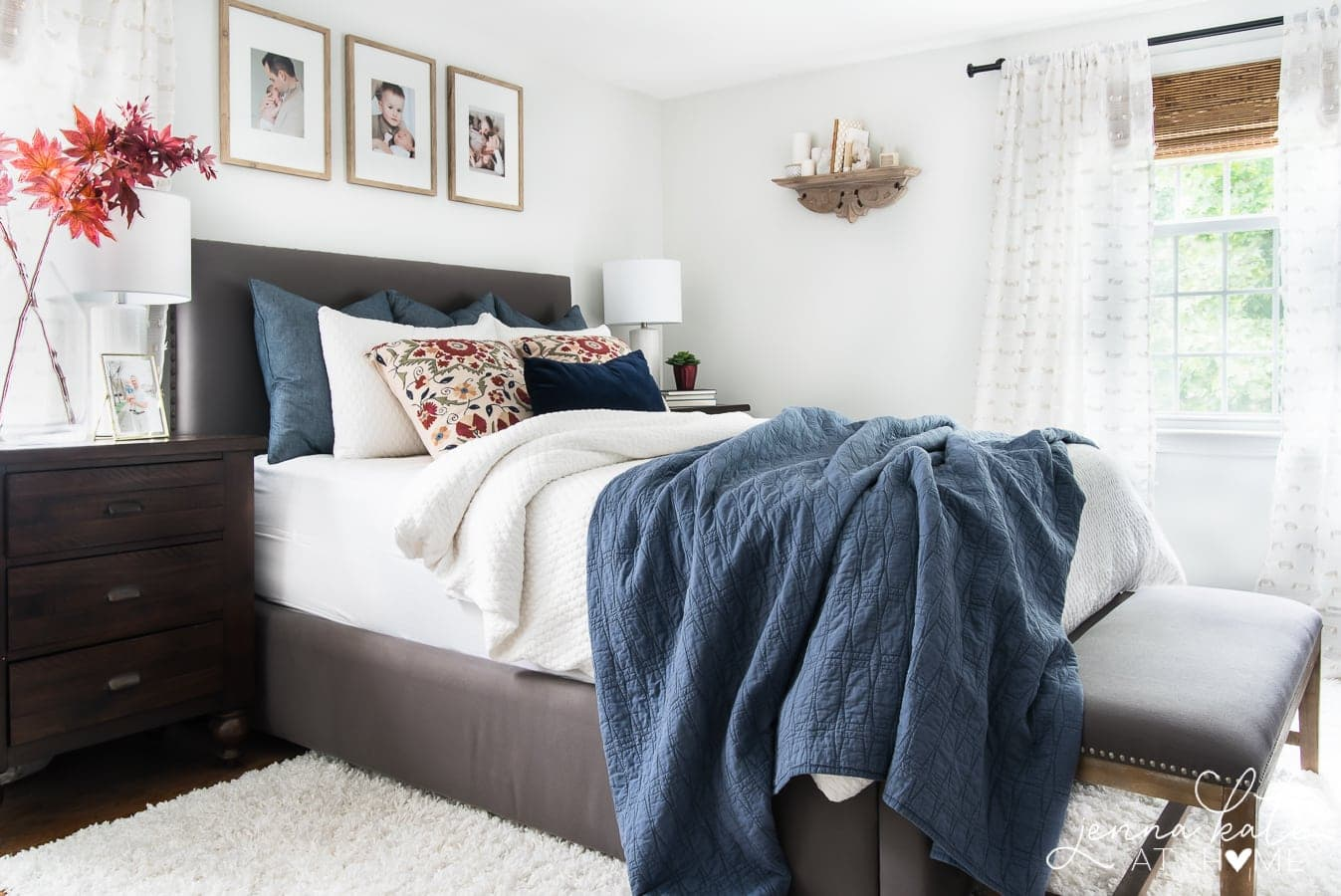 Bedroom decorated for fall with touches of dark red and denim blue