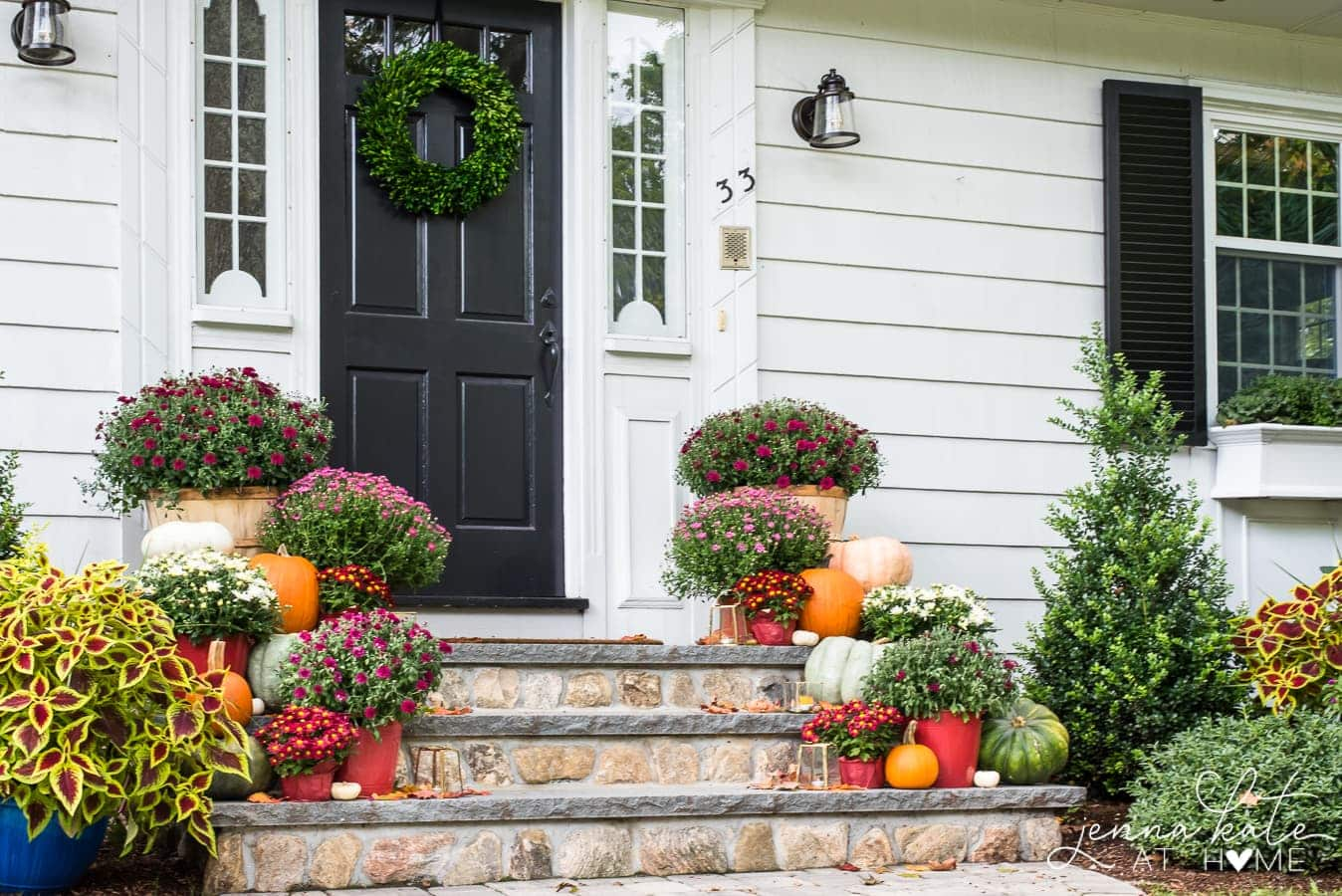 Traditional fall front porch decor with mums and pumpkins