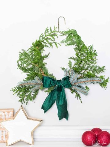 Easy DIY evergreen Christmas wreath using a dry cleaning wire hanger