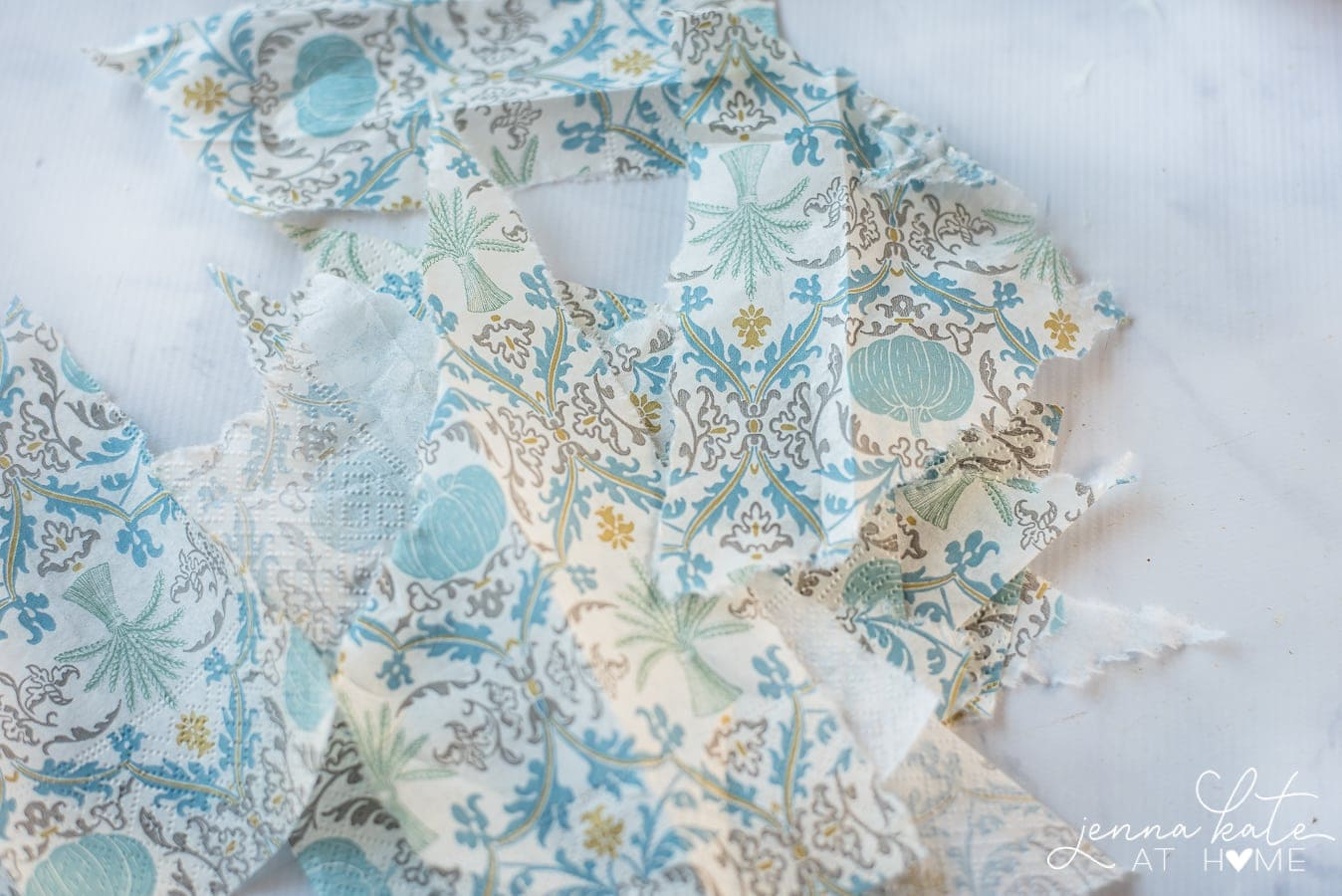 Blue and white paper napkins to be used to decoupage Christmas ornaments