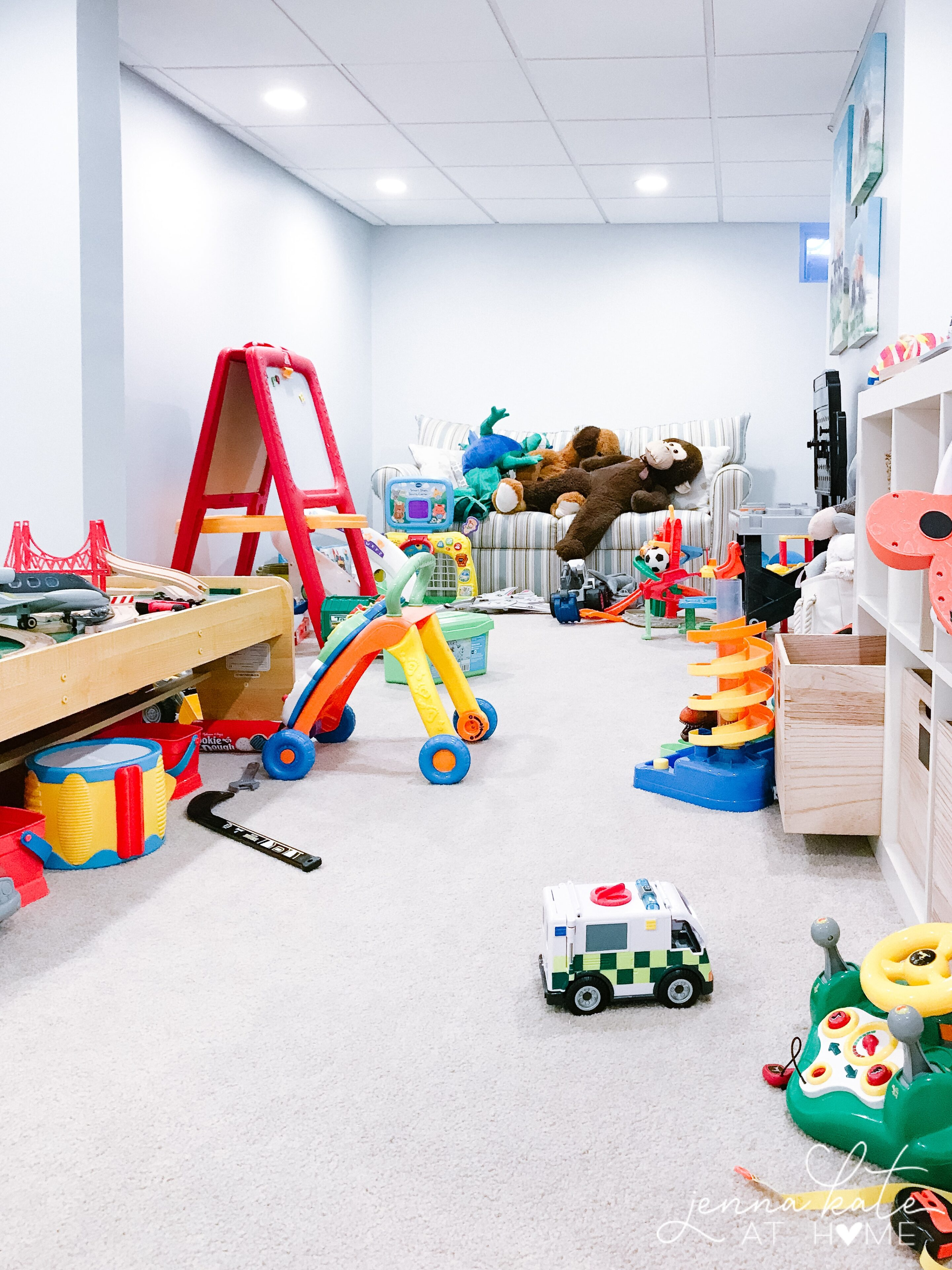 Messy playroom in need of toy organization