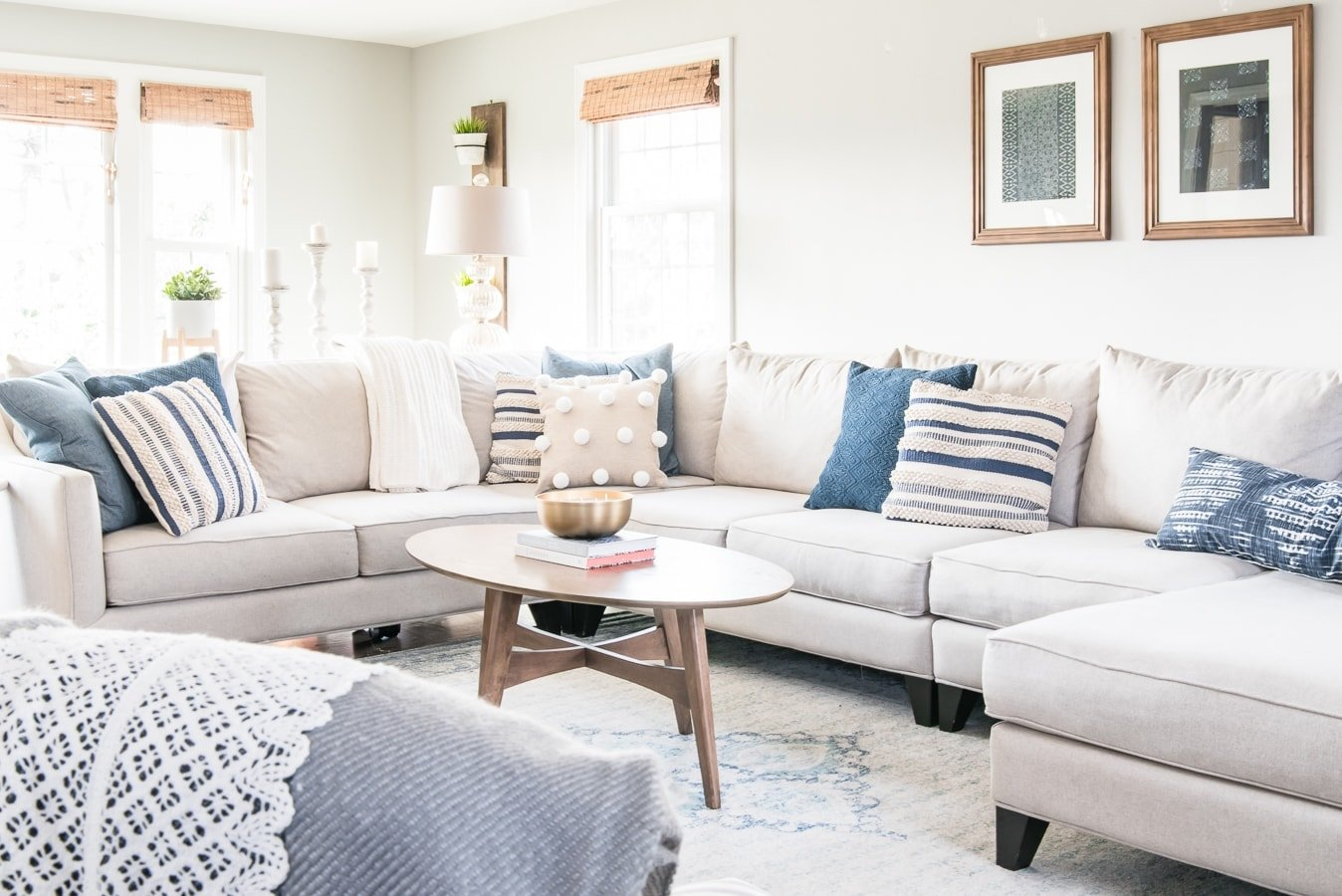sectional couch with a coffee table and winter decor