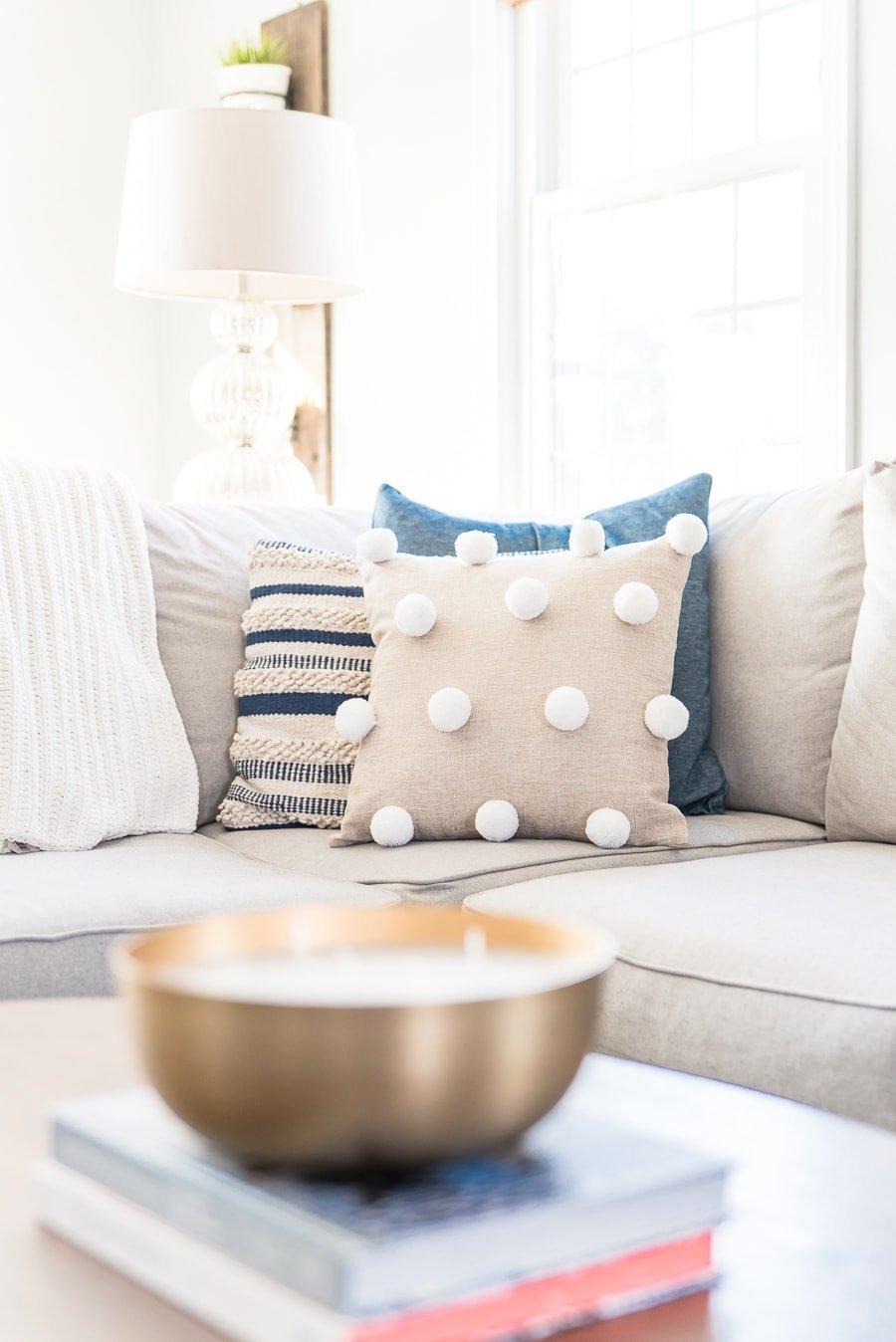 DIY pom pom pillow in couch