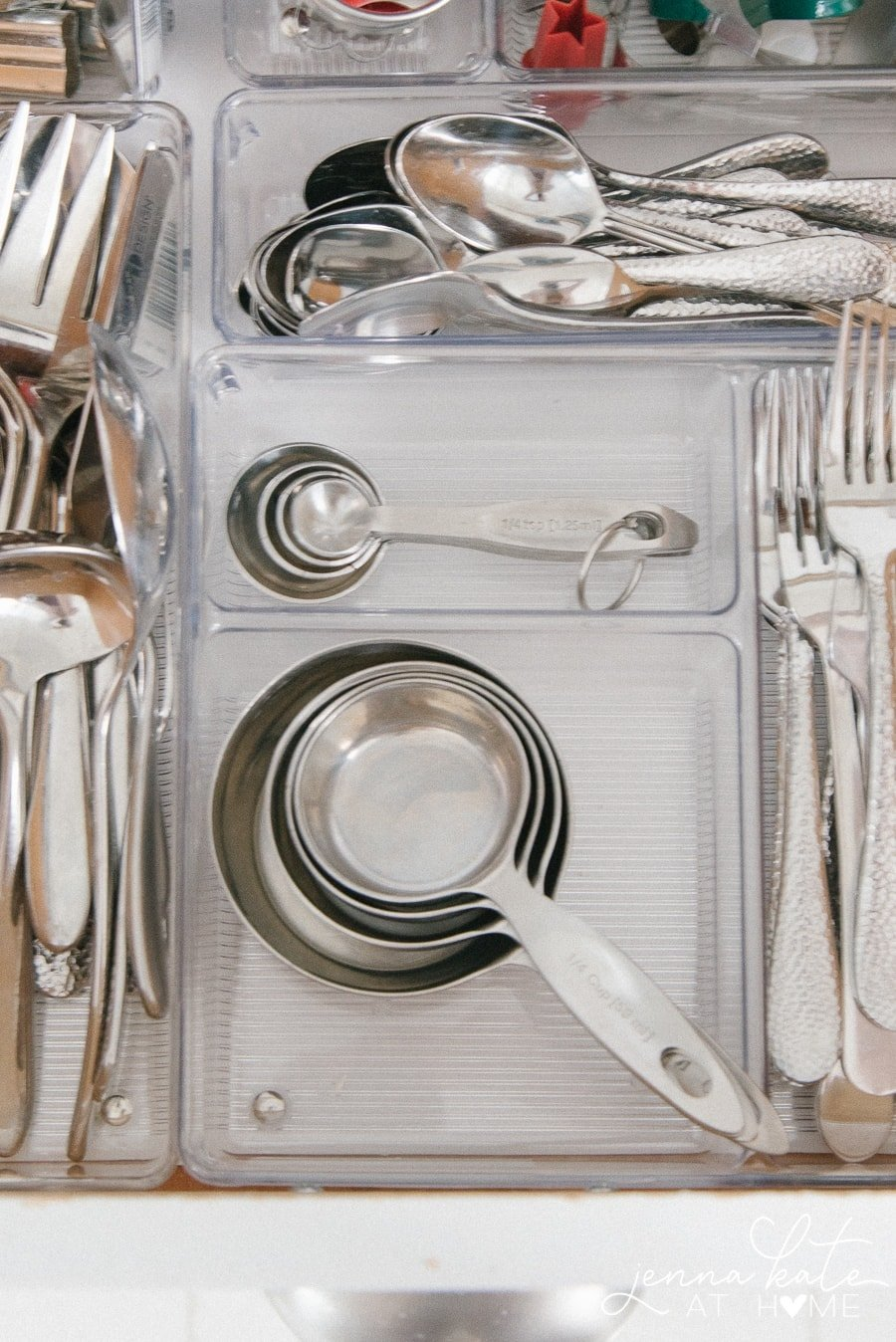 Organize all cutlery and bakeware supplies in a drawer with acrylic dividers