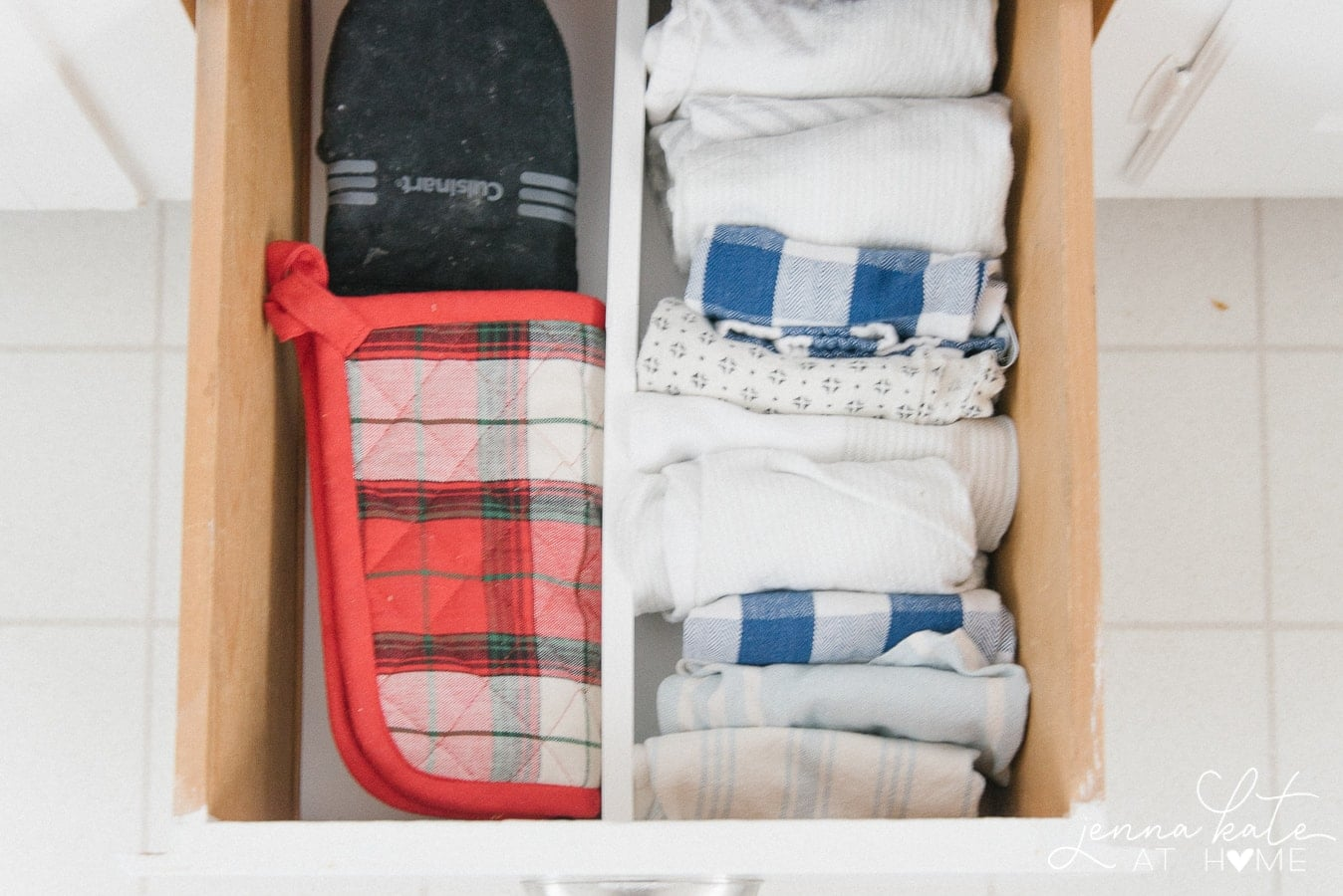 Organized towel drawer in the kitchen with a handy divider