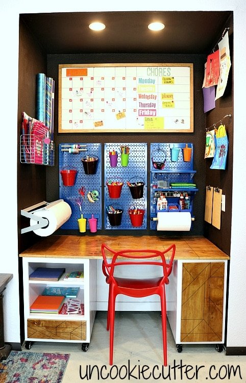 Craft station for kids with pegboards in adult space keeps kids' supplies organized and away from the adult supplies