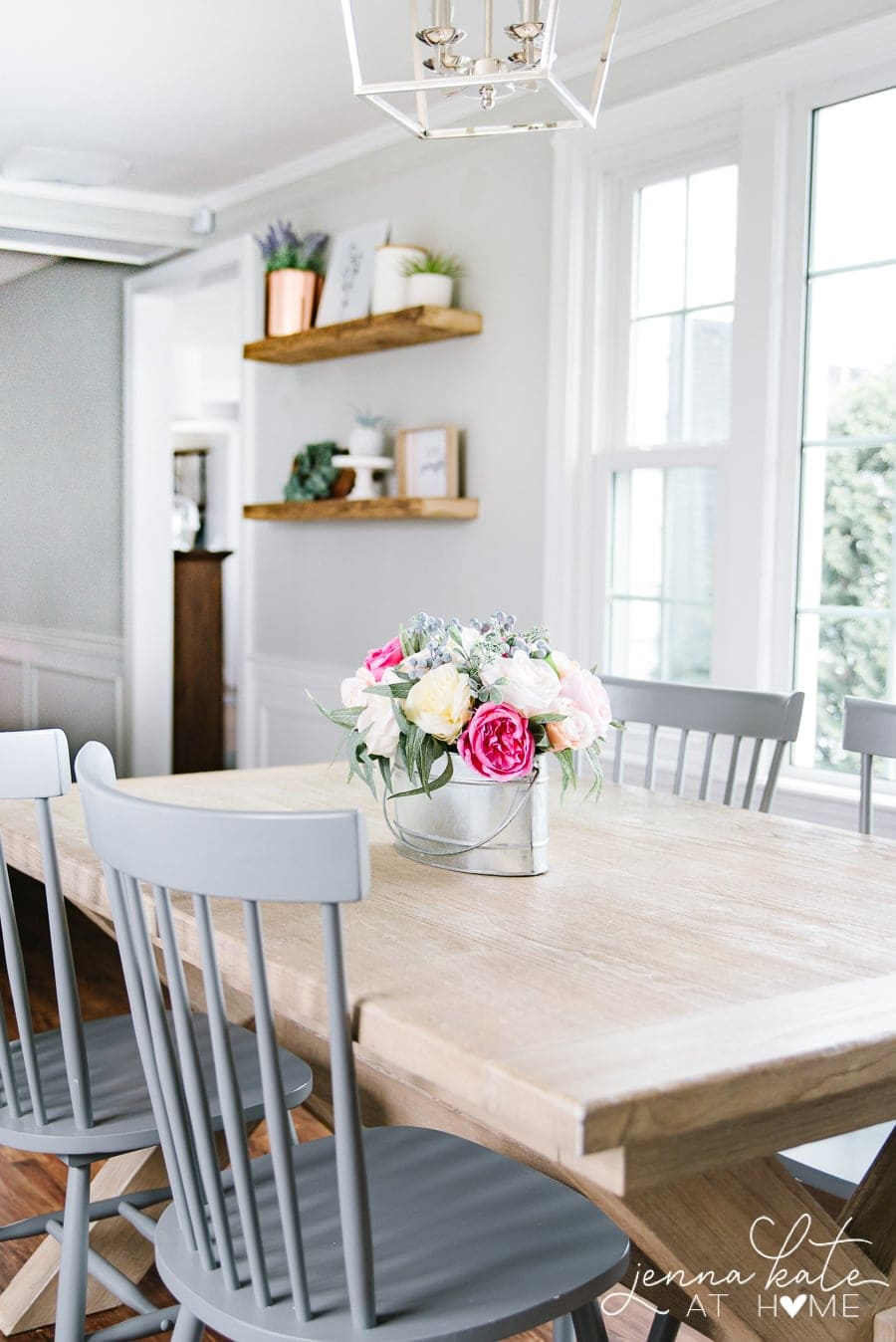 view over a kitchen table to a wall painted with repose gray