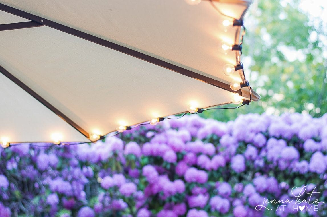 Add string lights to your outdoor entertainment areas like picnic tables and umbrellas for extra light and ambiance.