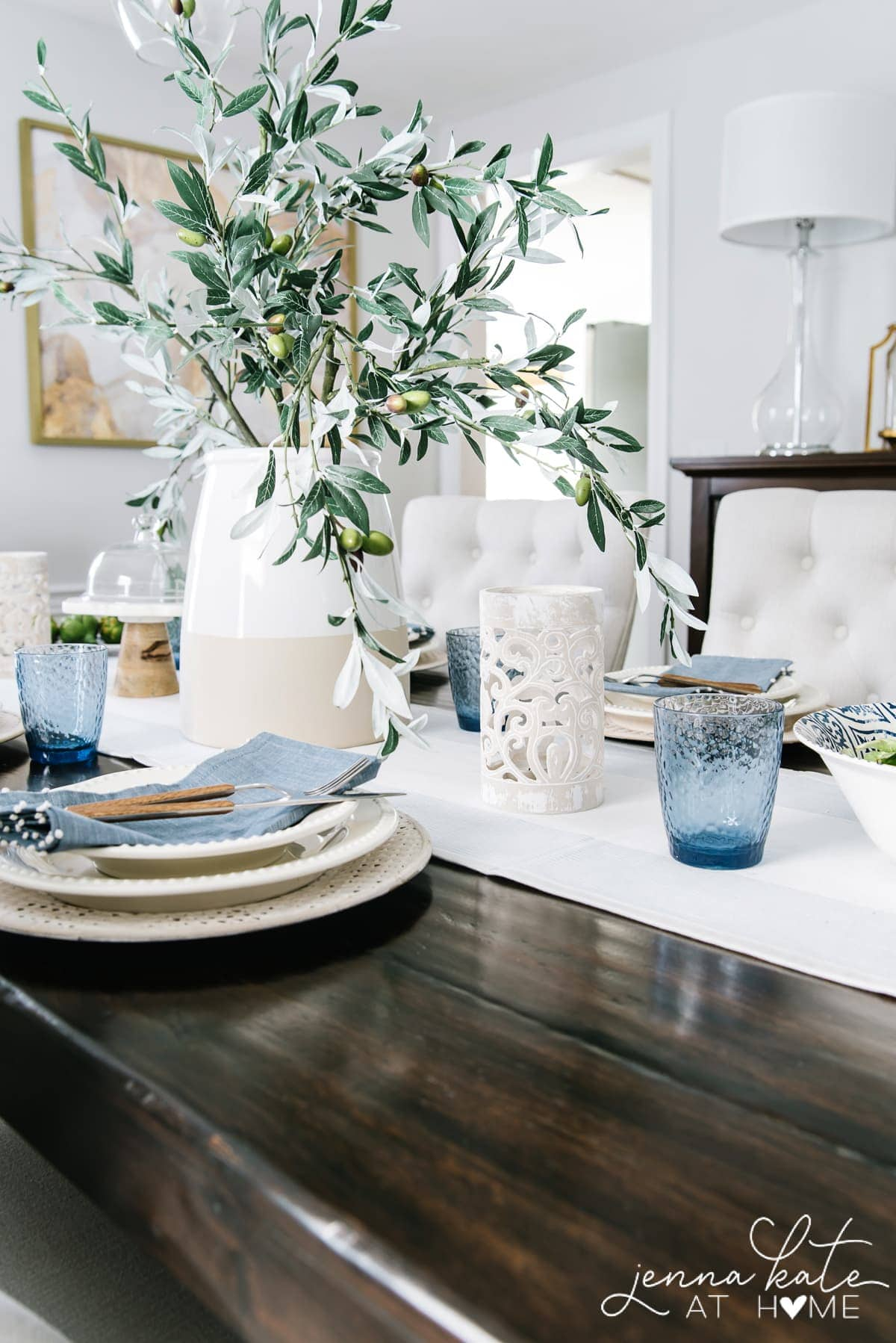 summer tablescape with blue napkins and glasses