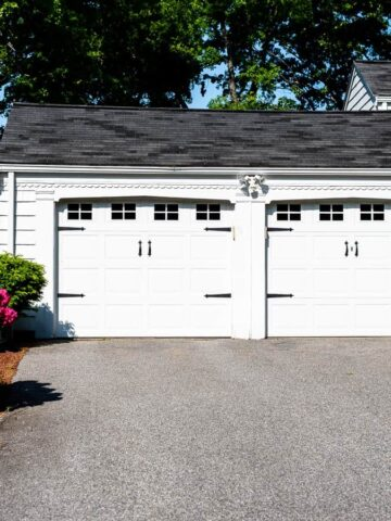 A double garage with black vinyl decals (representing windows) and plastic hardware