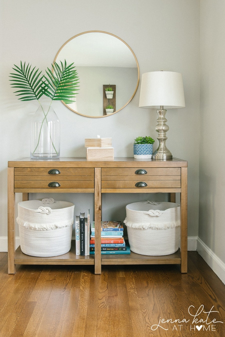 living room console table with toy storage baskets underneath
