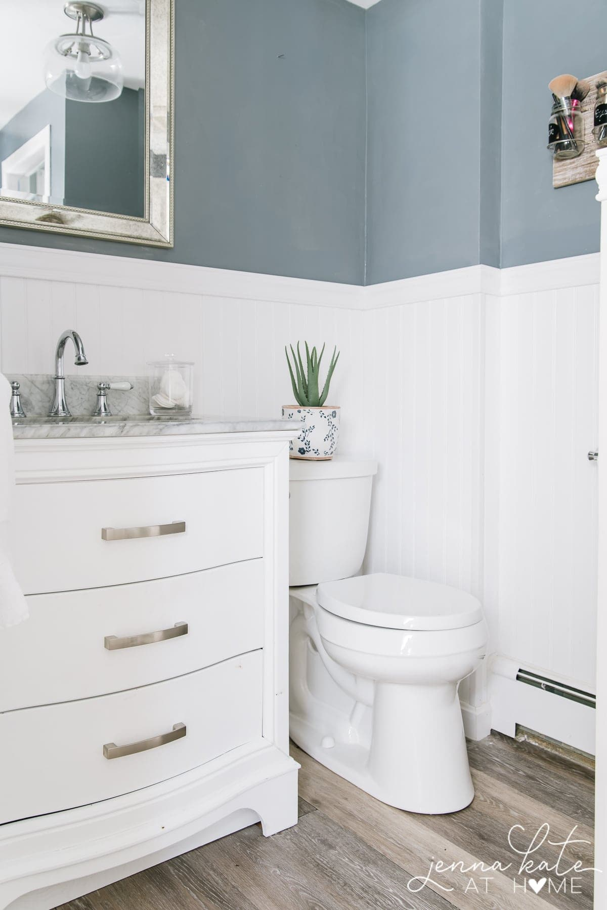 before of bathroom - white beadboard walls with dark gray-blue walls