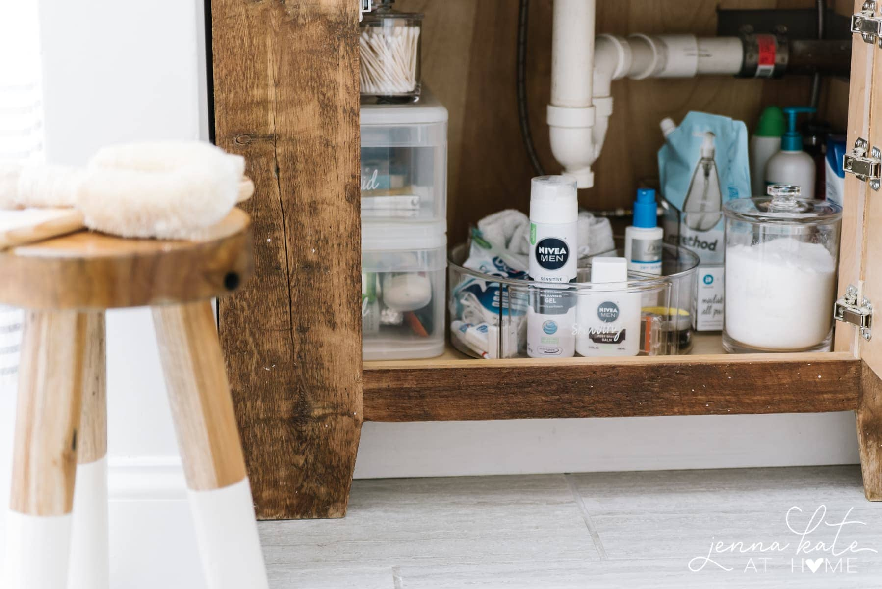 how do you organize bathroom toiletries in a cabinet
