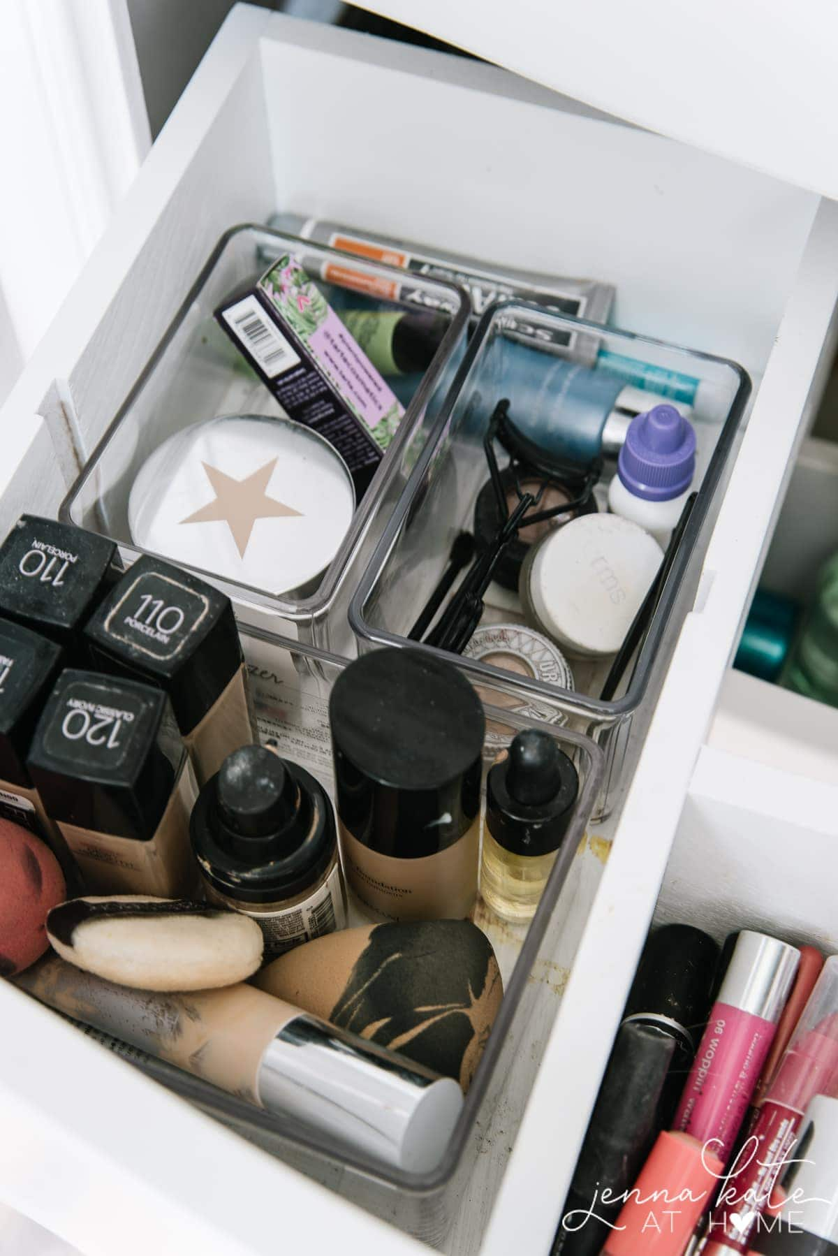 Acrylic storage bins for makeup in bathroom