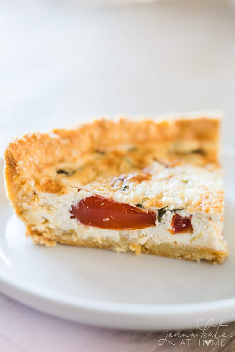 This tomato pie has layers of juicy tomato and basil in a creamy buttermilk parmesan custard filling