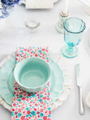 colorful plates, napkins and glasses on a table