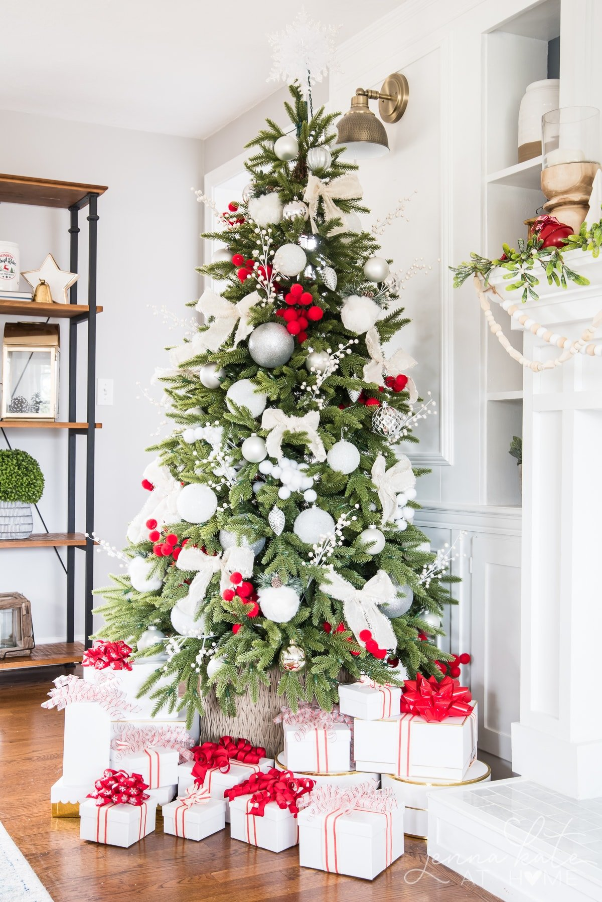 Artificial Christmas tree with red and white decorations
