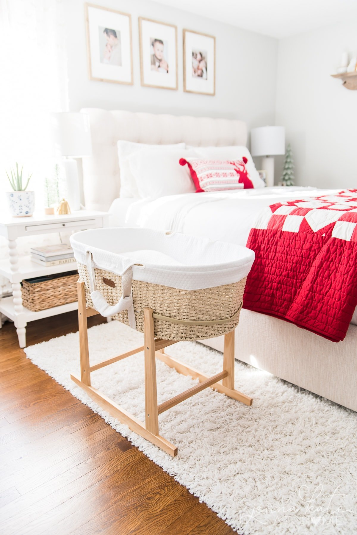 Bedroom decorated for Christmas with a bassinet next to the bed