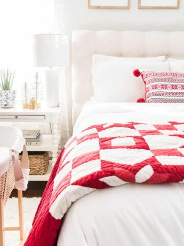 Bed with red and white quilt for Christmas