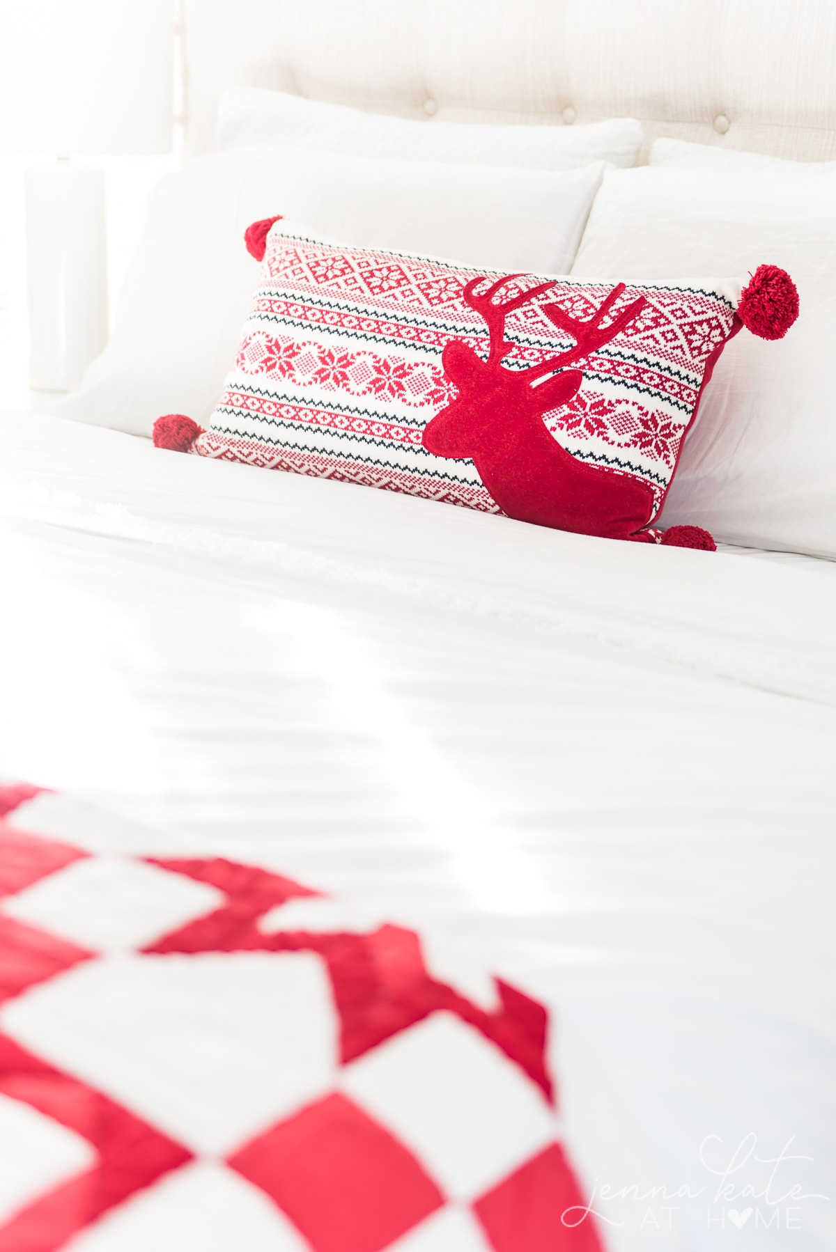 Red Christmas throw pillow with a reindeer silhouette