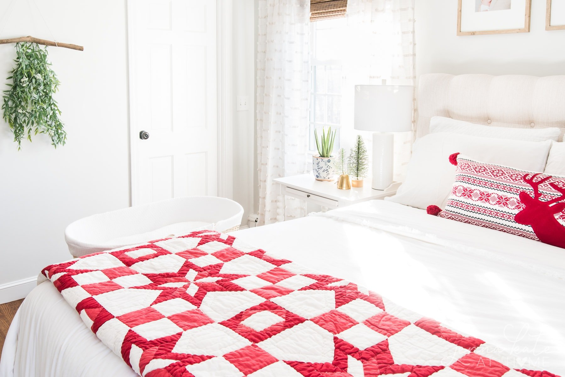Bedroom with quilt on the bed