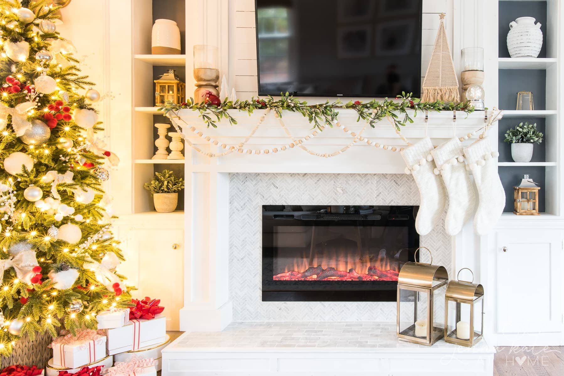 Christmas mantel decorations with faux garland beads and hanging stockings