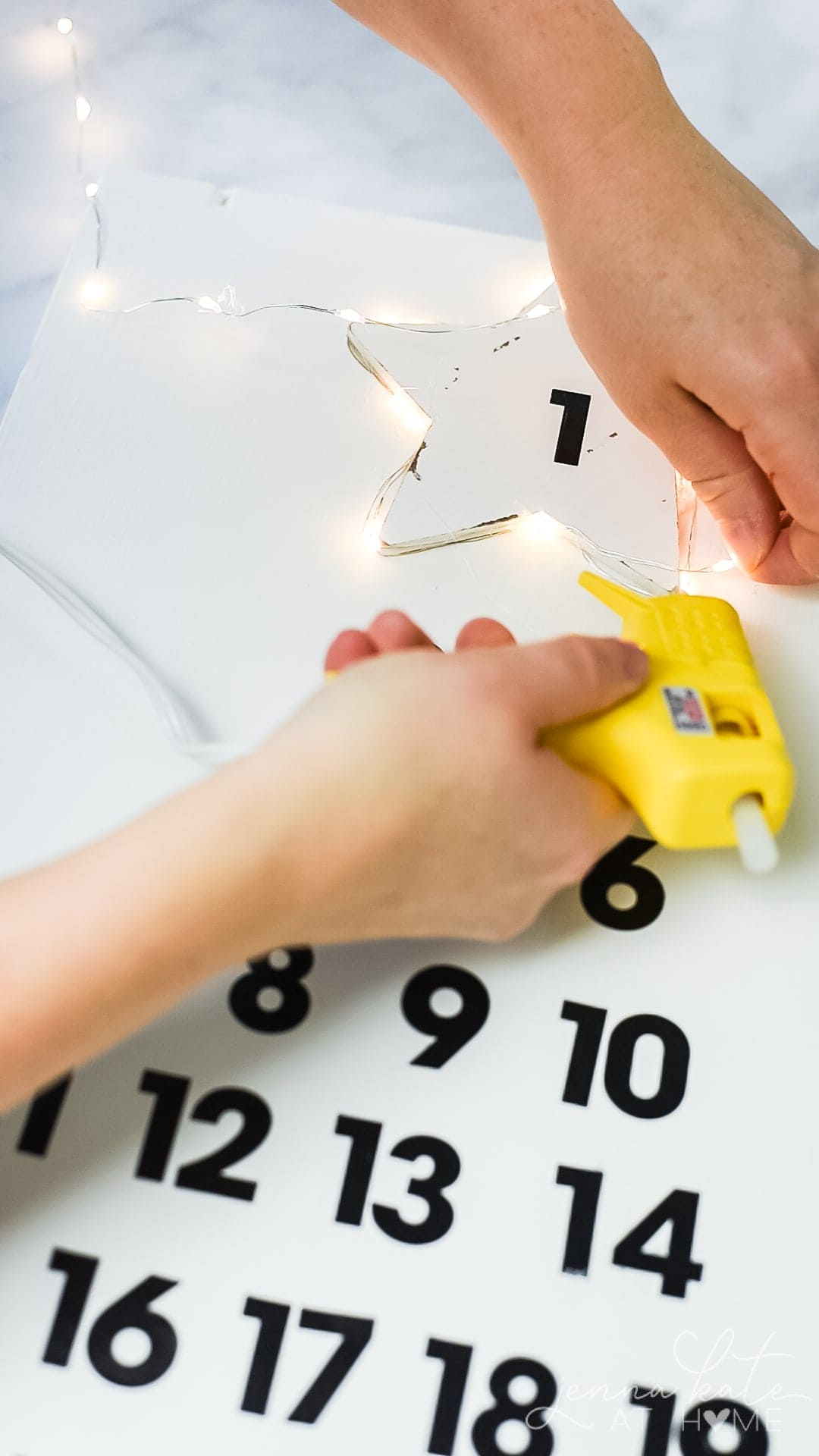 Add bright twinkling lights to your DIY wooden advent calendar