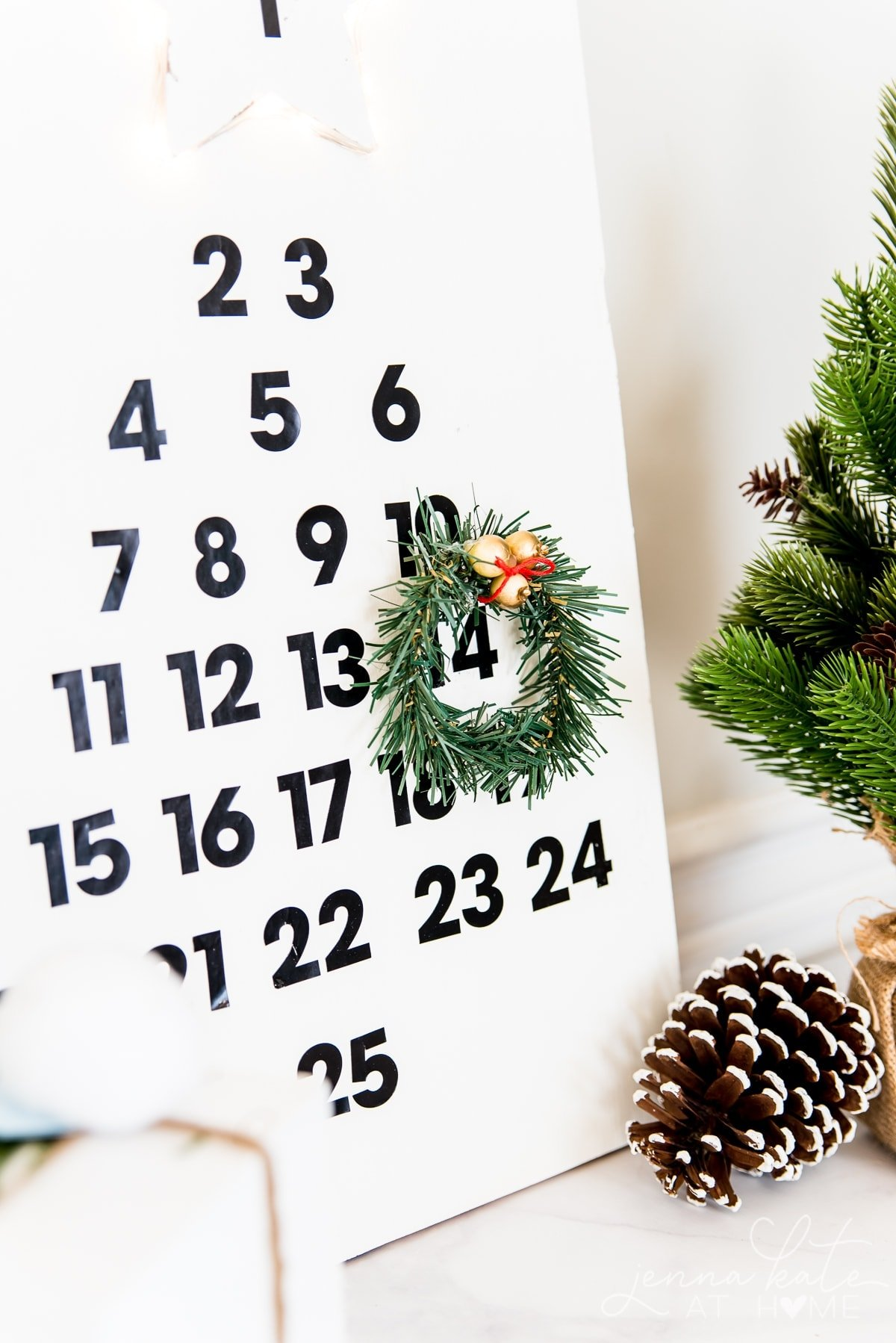 Your kids will love moving the wreath every day on this DIY wooden advent calendar