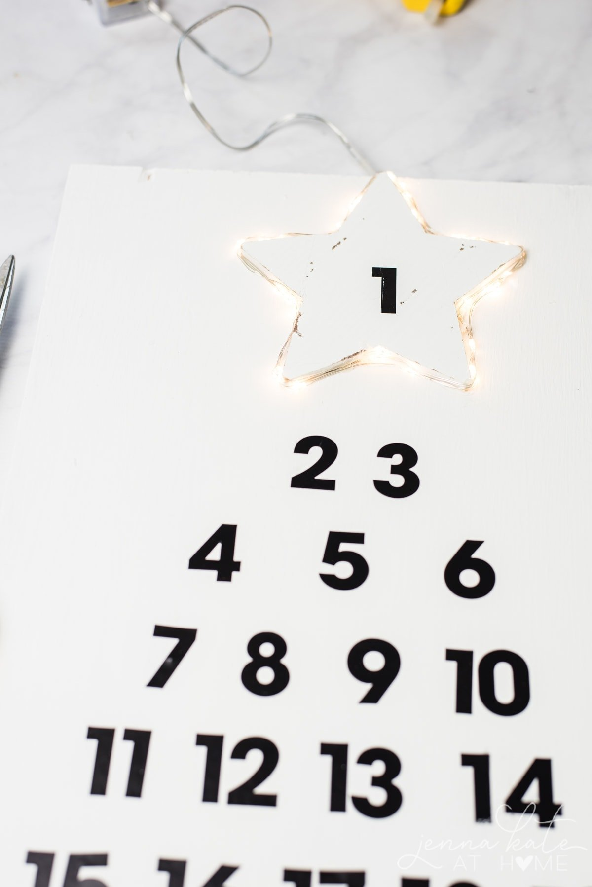 Bright twinkling lights add an extra Christmas touch to this DIY wooden advent calendar
