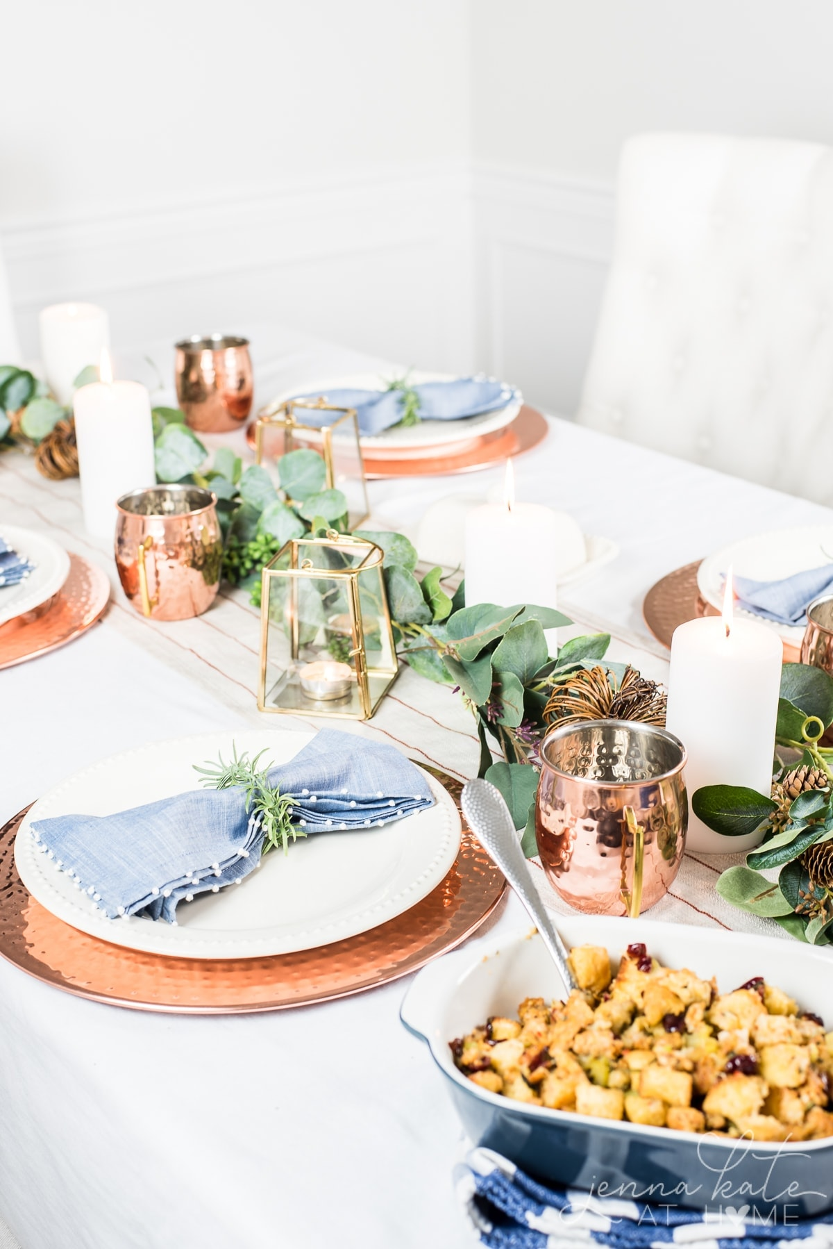 My Thanksgiving tablescape is a non-traditional theme of warm copper dinnerware and green foliage