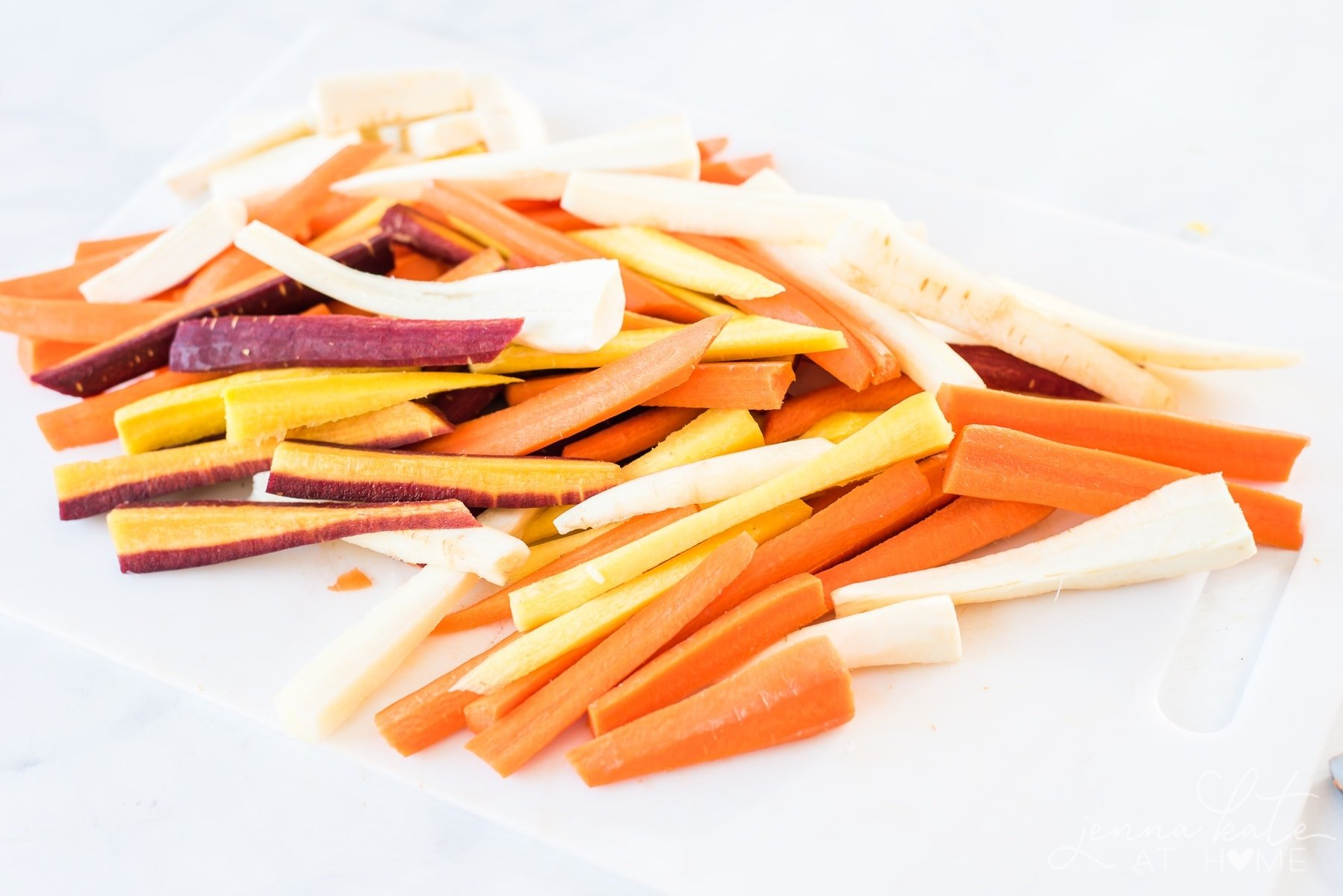 These colorful root vegetables are fresh and ready to be roasted to perfection for this one-pan Thanksgiving dinner