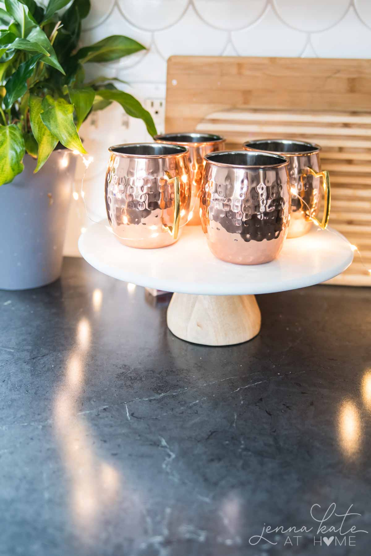 Copper mugs on a cake stand