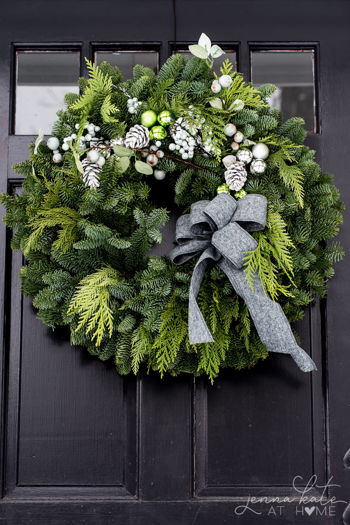 Evergreen Christmas wreath with a gray bow