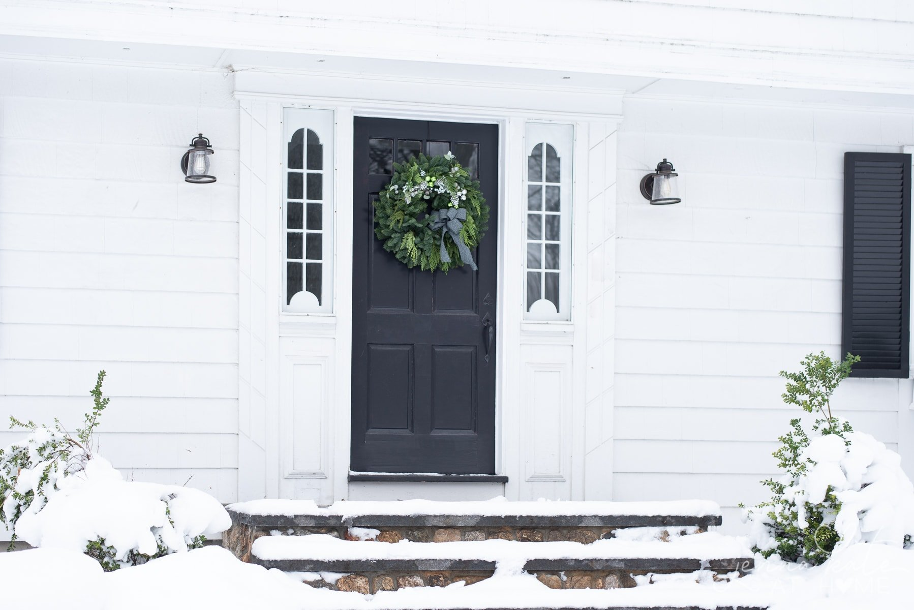 Front entryway with the steps covered in snow