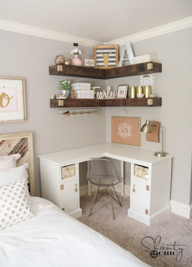 Corner shelves help define a corner of a bedroom to make an office space in a small room
