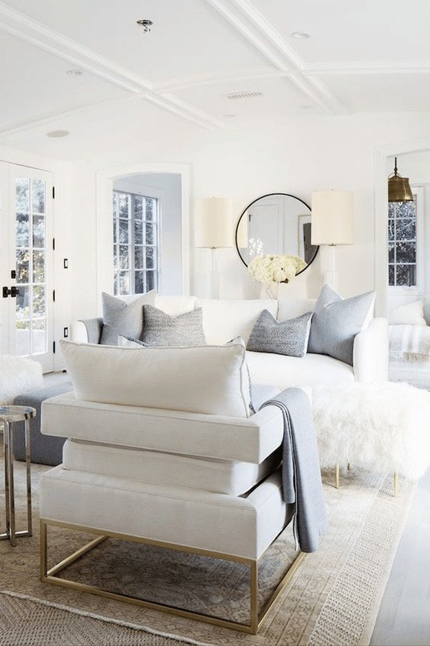 Bright white living room with white furniture