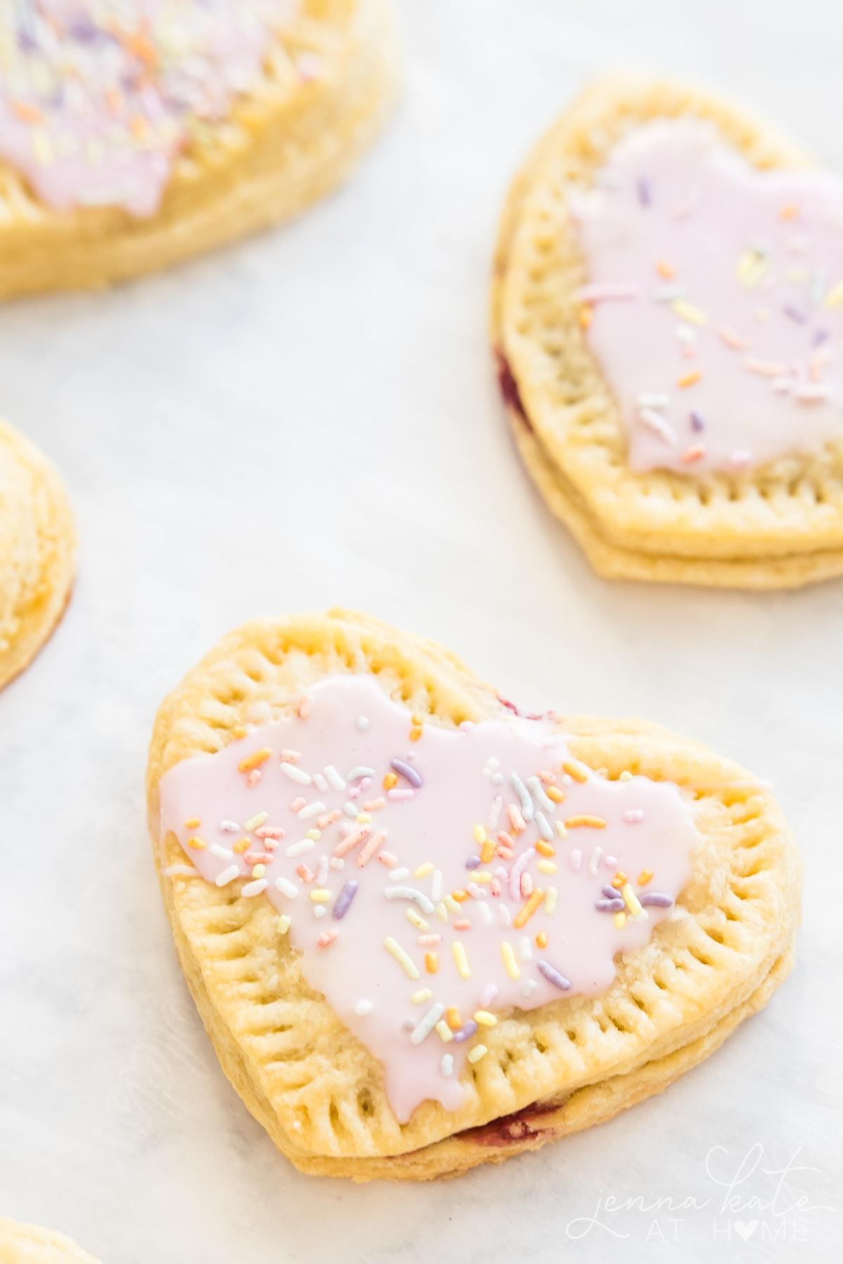 Homemade heart shaped pop tarts with vanilla icing