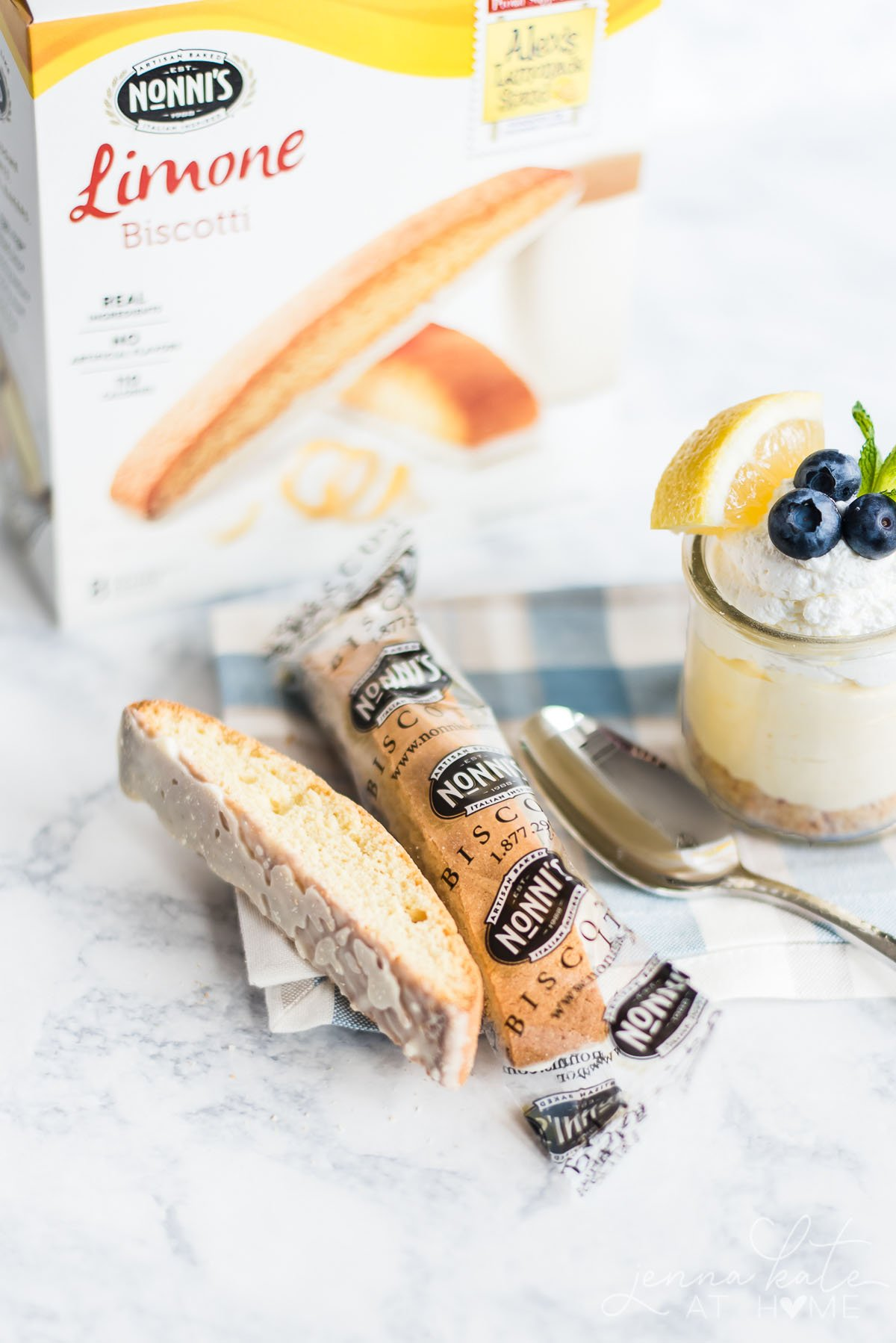 Nonni's Limone Biscotti packaging alongside the Lemon Mousse Cheesecake