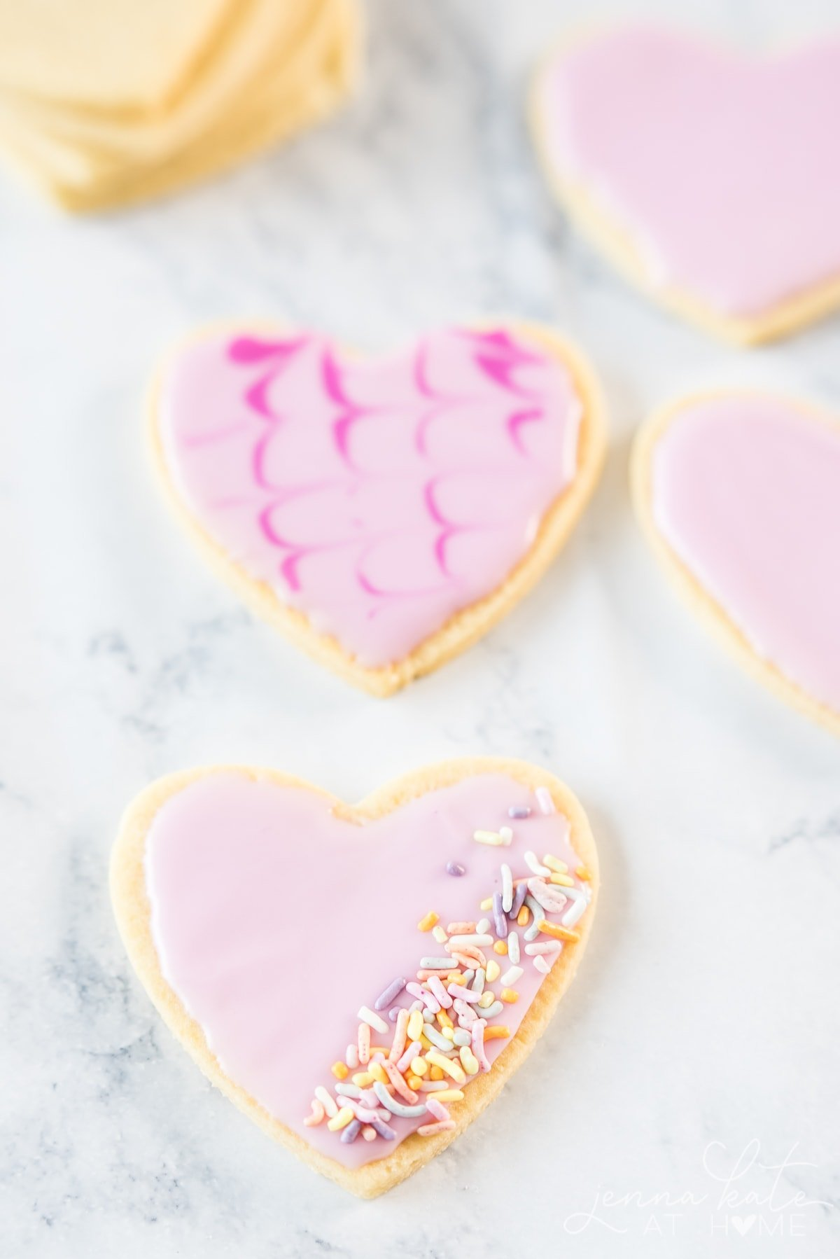 Easy valentine's sugar cookie recipe with icing and sprinkles