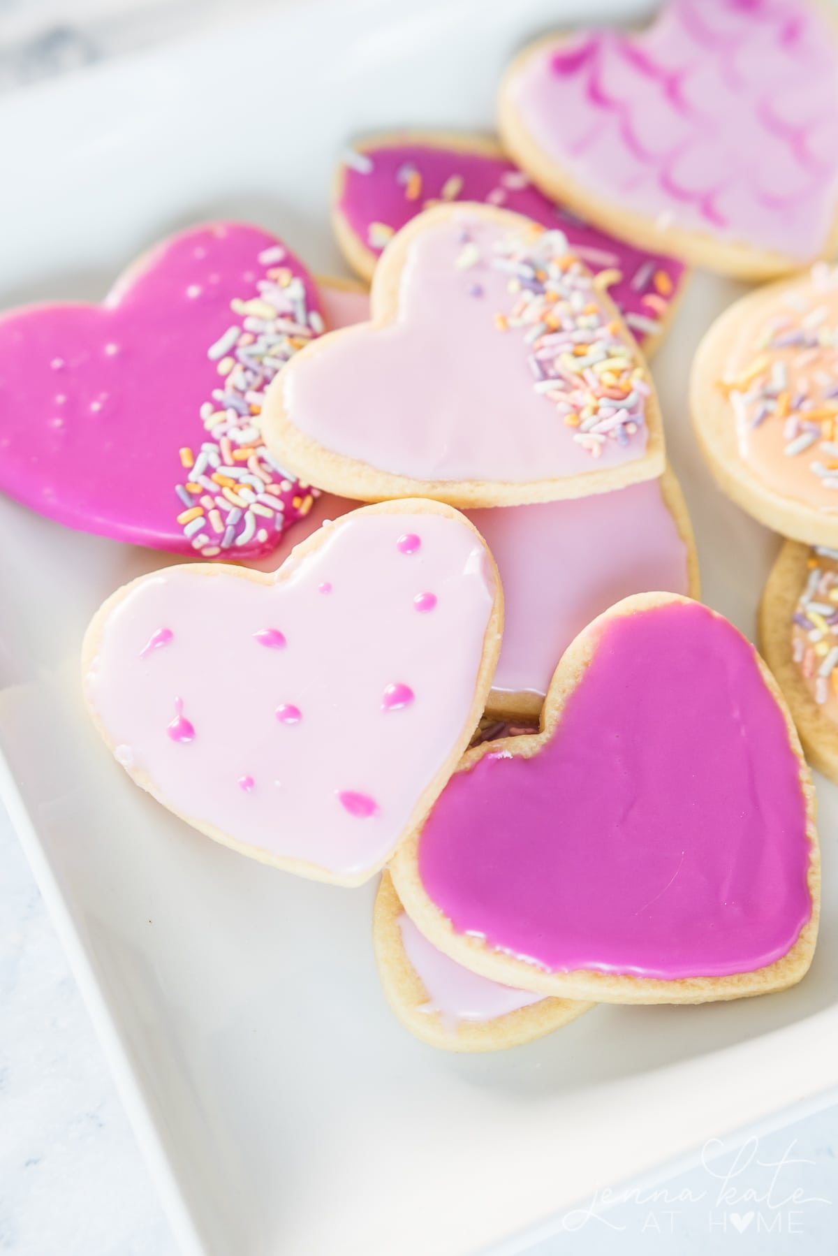 confectioners sugar icing made pink on frosted cut out cookies