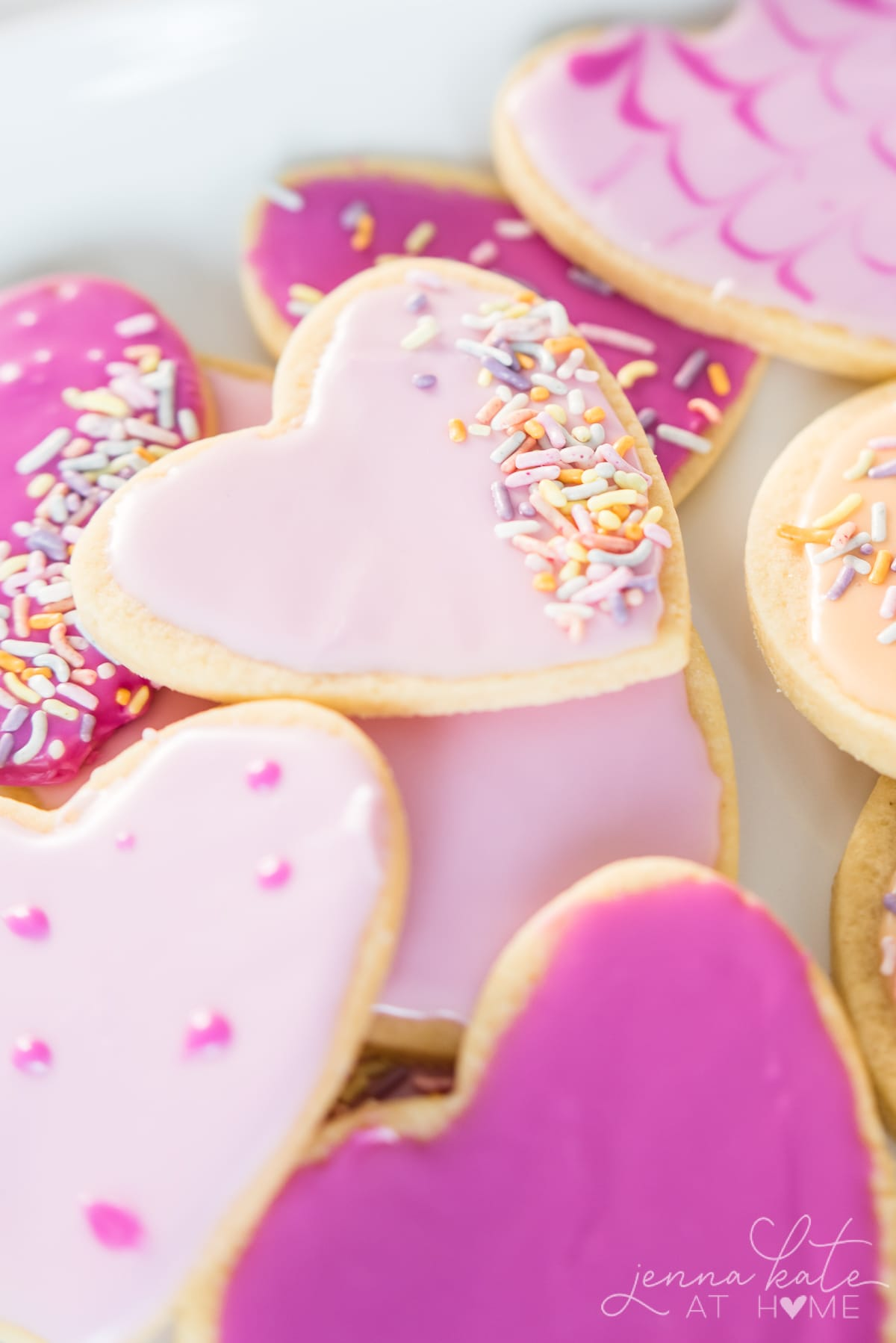 heart shaped cookies piled on a plate