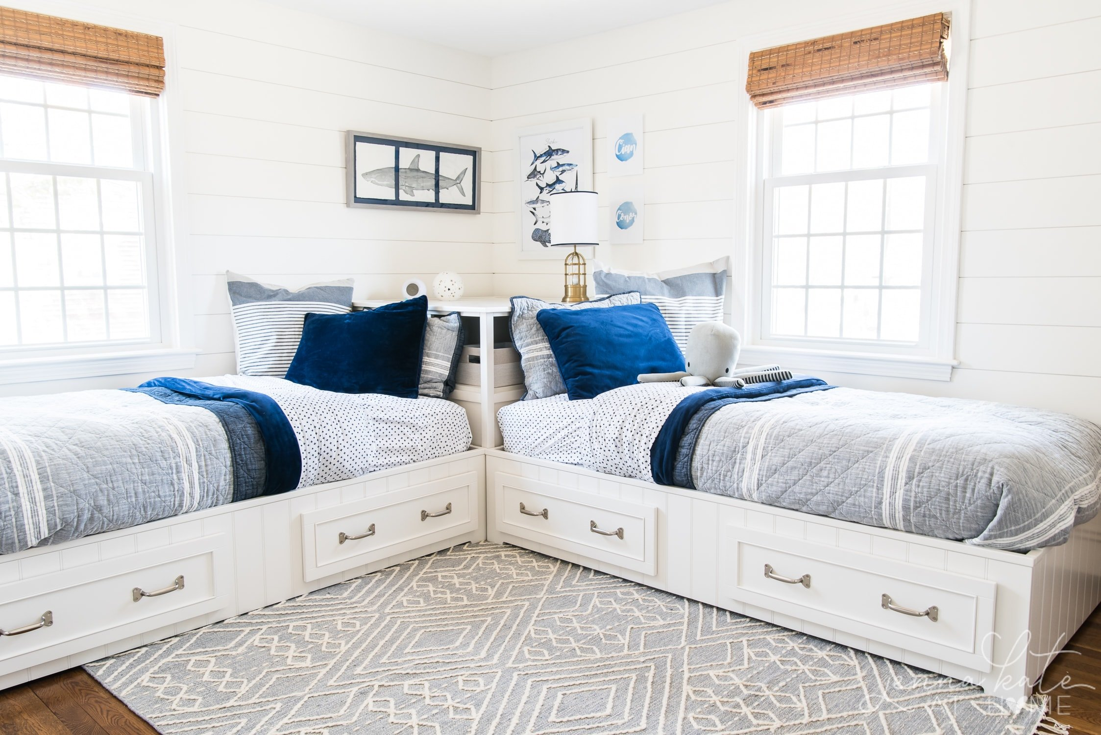 shared boy bedroom with two twin beds with navy and gray bedding