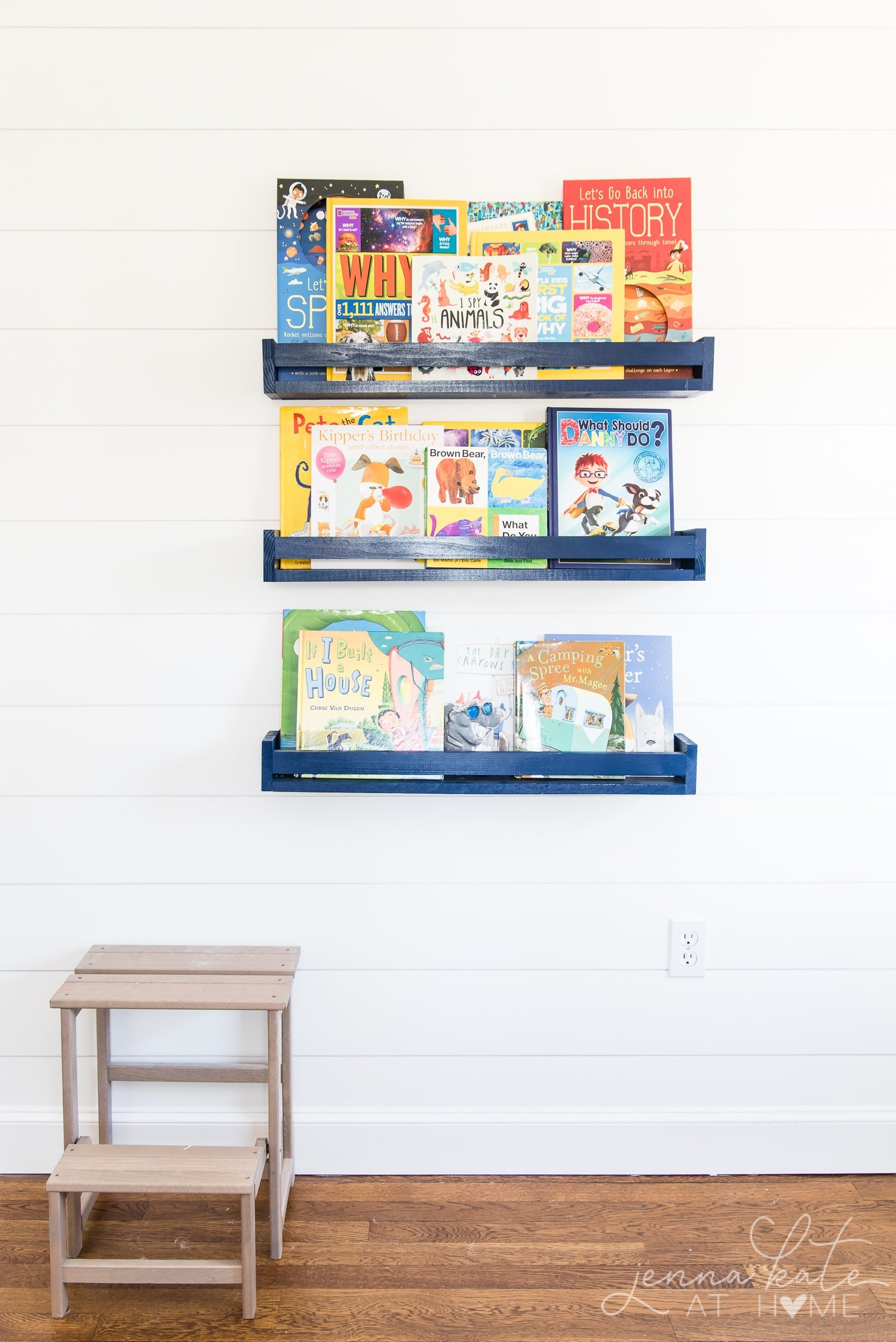 Kids bedroom with shiplap wall painted Benjamin Moore Simply White with navy blue book ledges. Boy bedroom decor ideas