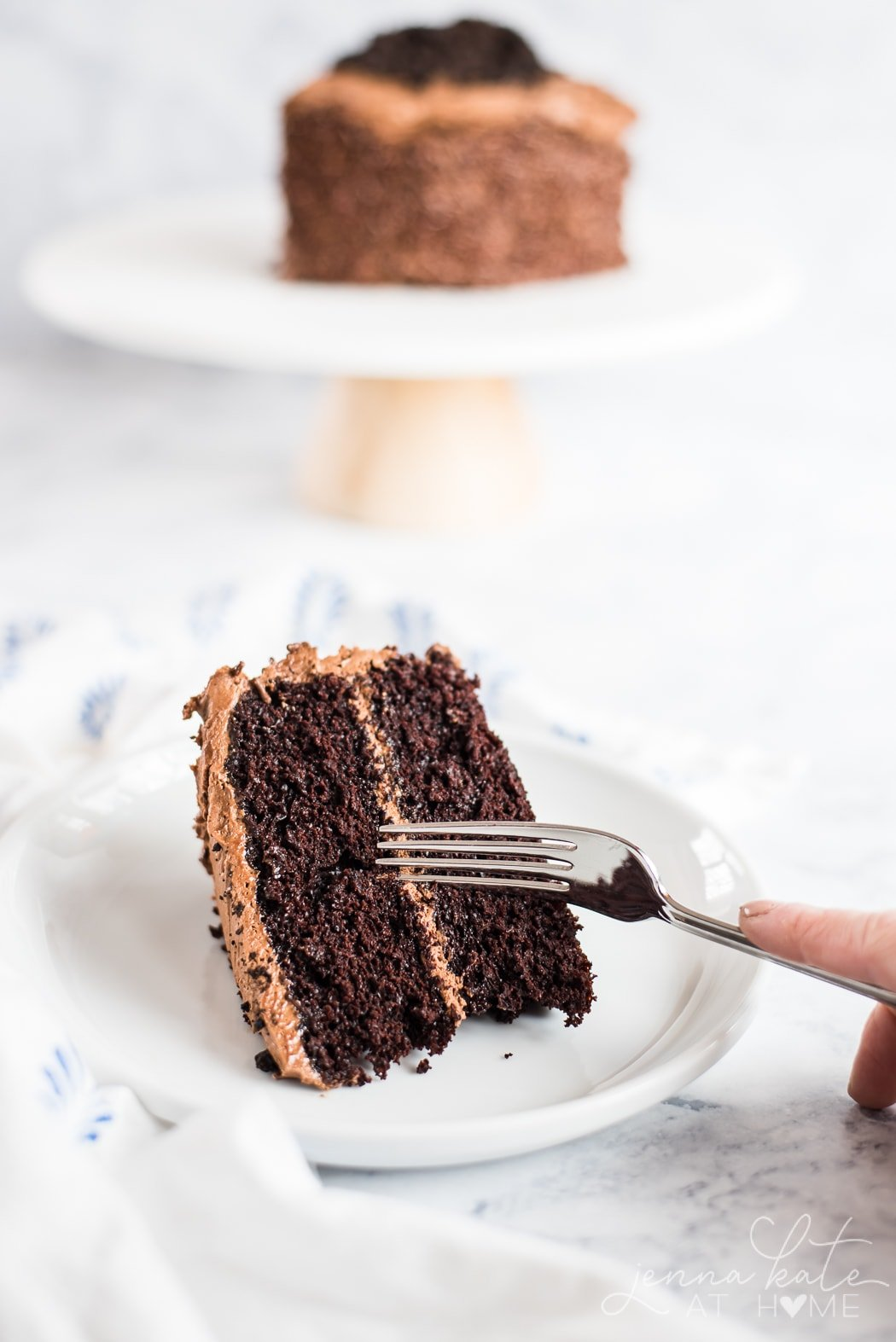 Fork cutting in to chocolate birthday cake.