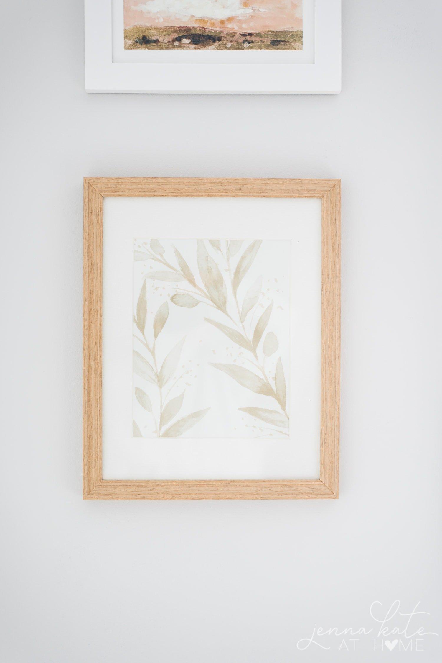 Scrap of floral wallpaper framed in a natural wood frame