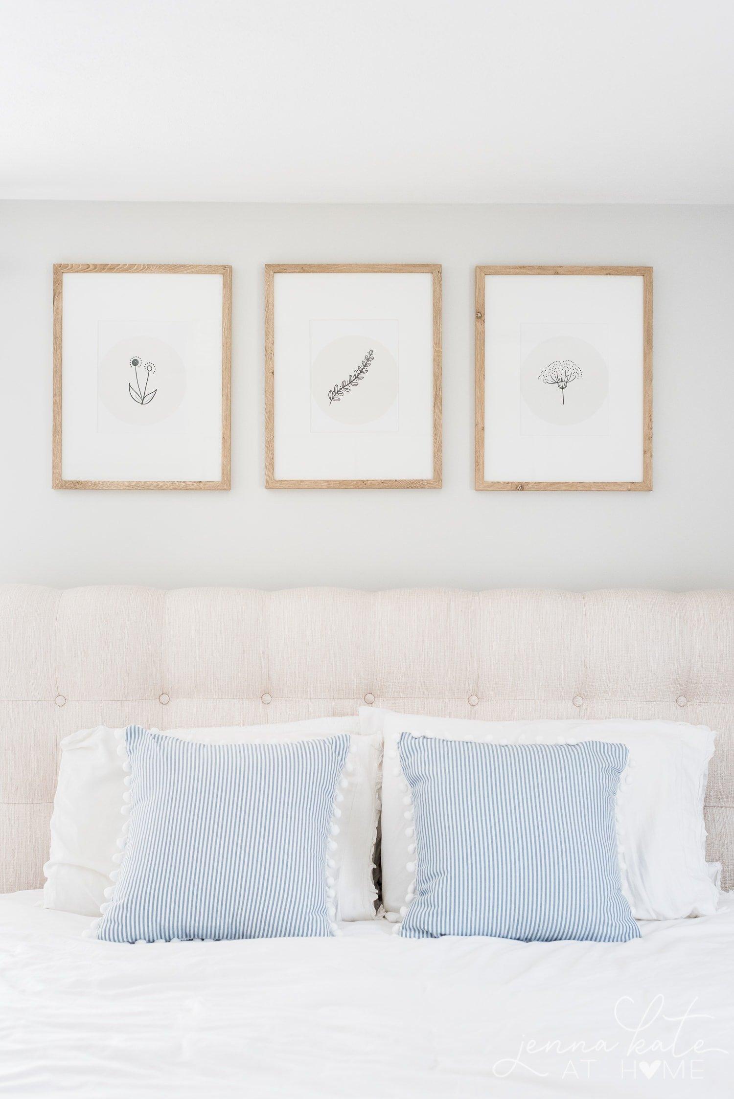 neutral floral doodle wall art framed over bed