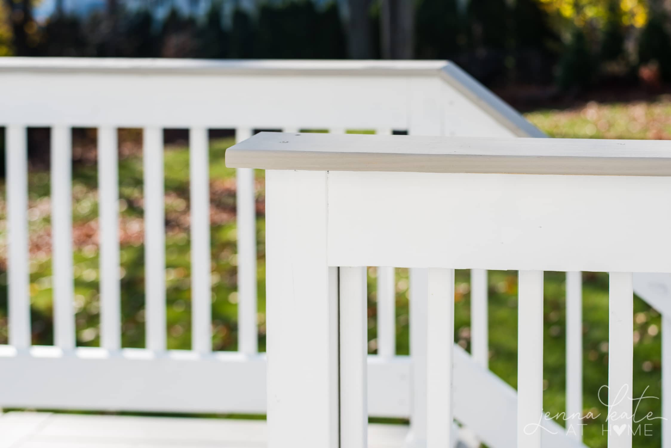 Wood deck painted Sherwin Williams Extra White with the Intellectual Gray as the contrasting color