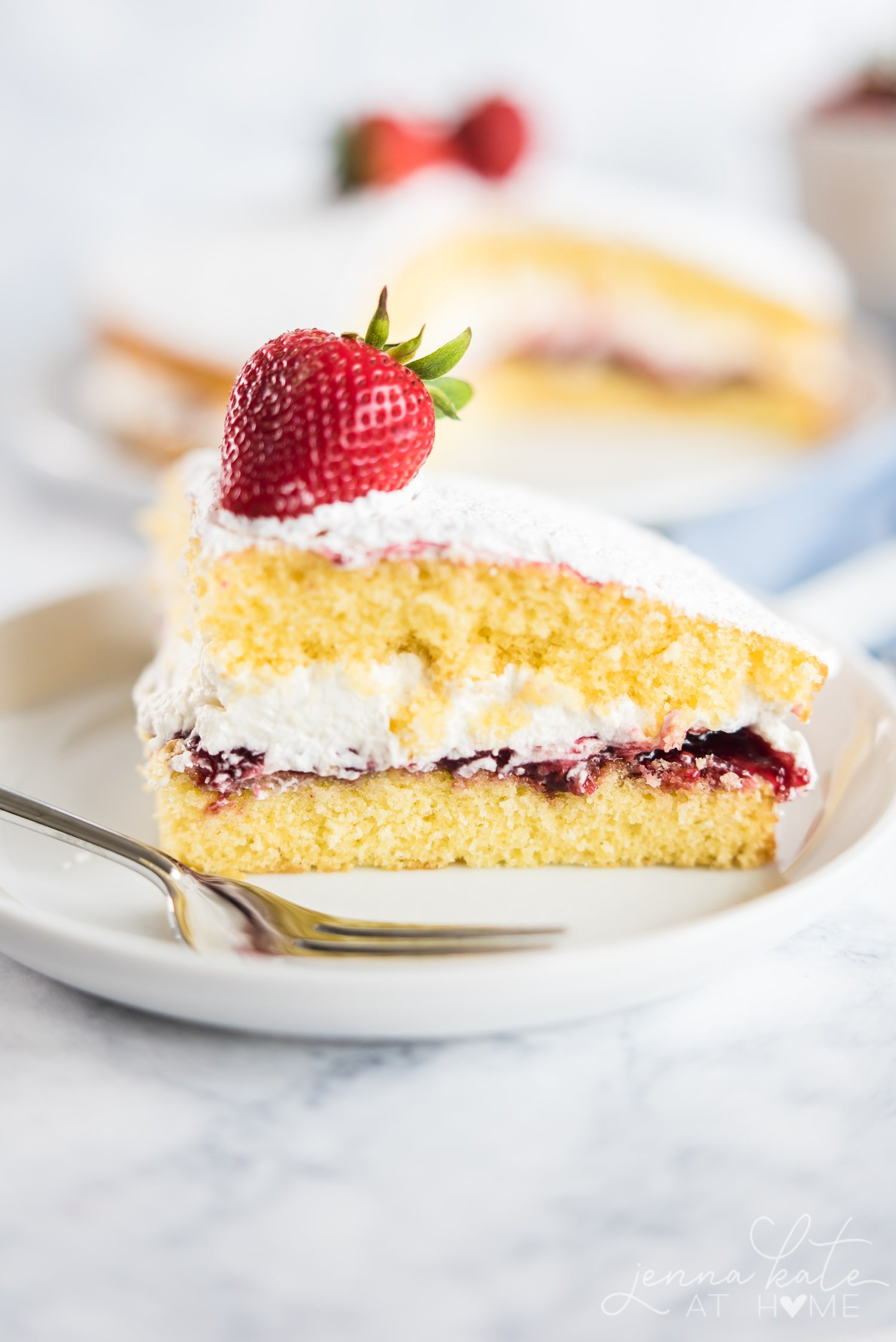 Slice of the cake where you can see the jam and cream filling