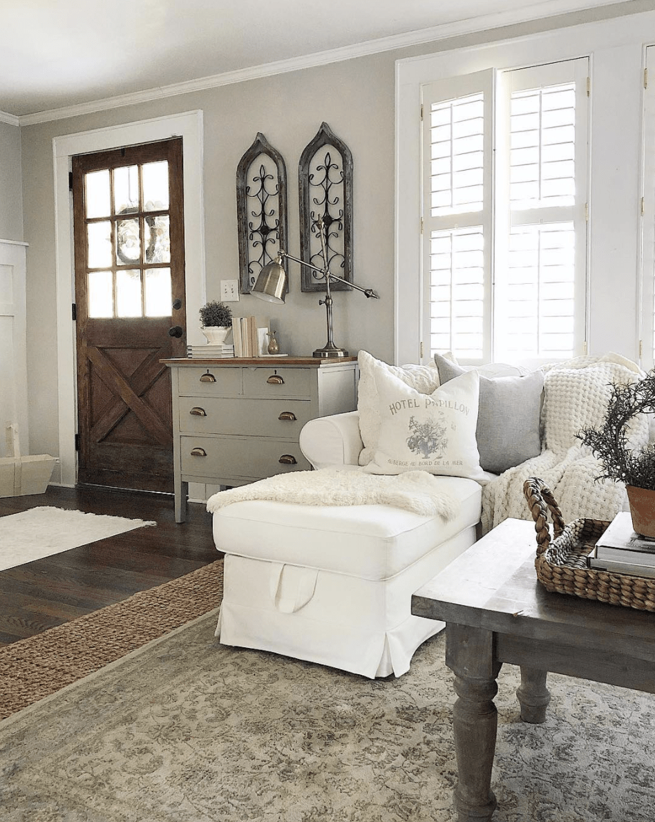 Farmhouse style living room with lots of dark show shows that Agreeable Gray works for all styles