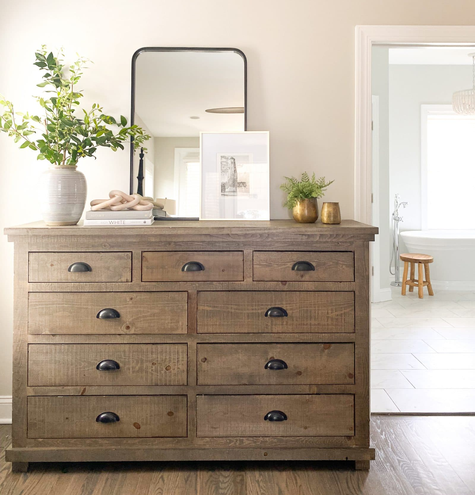 Wood dresser with agreeable gray walls behind